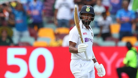 Pujara digs deep for gritty fifty in India's run chase