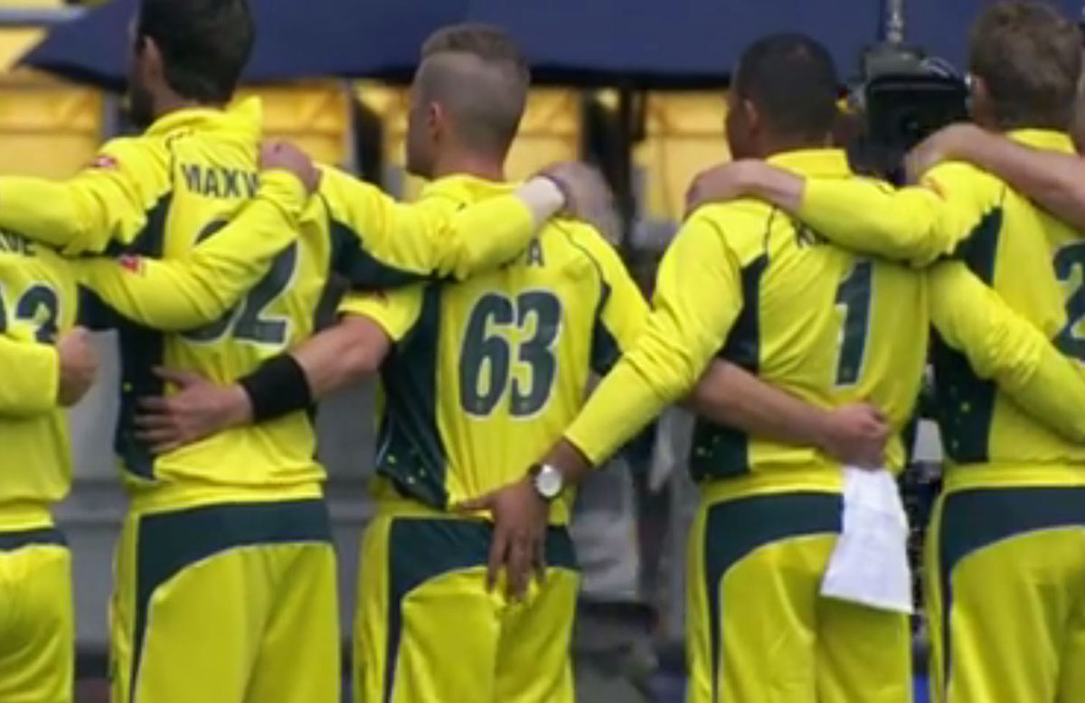 Usman Khawaja and Adam Zampa get close and personal