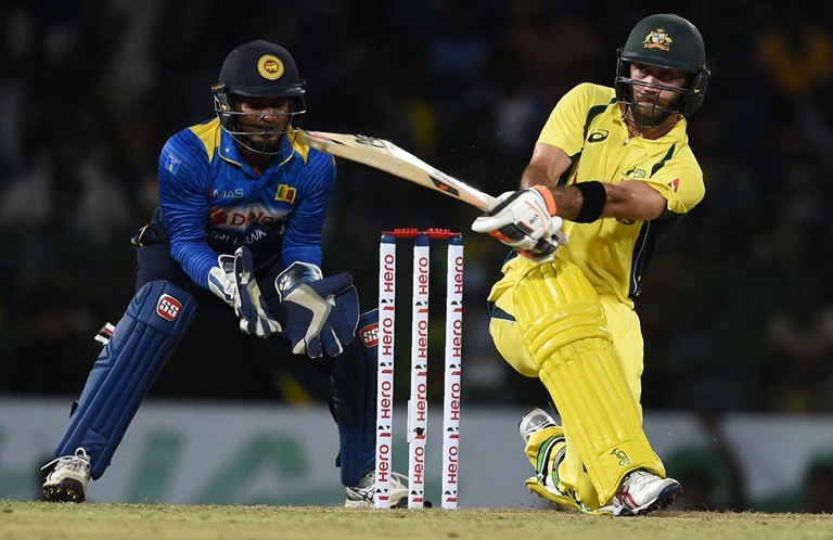 Magical-Maxwell-smashes-record-half-century-still