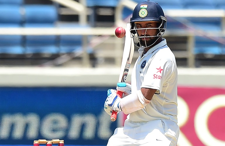 Pujara-Henry-shine-on-tense-day-in-Kolkata-still
