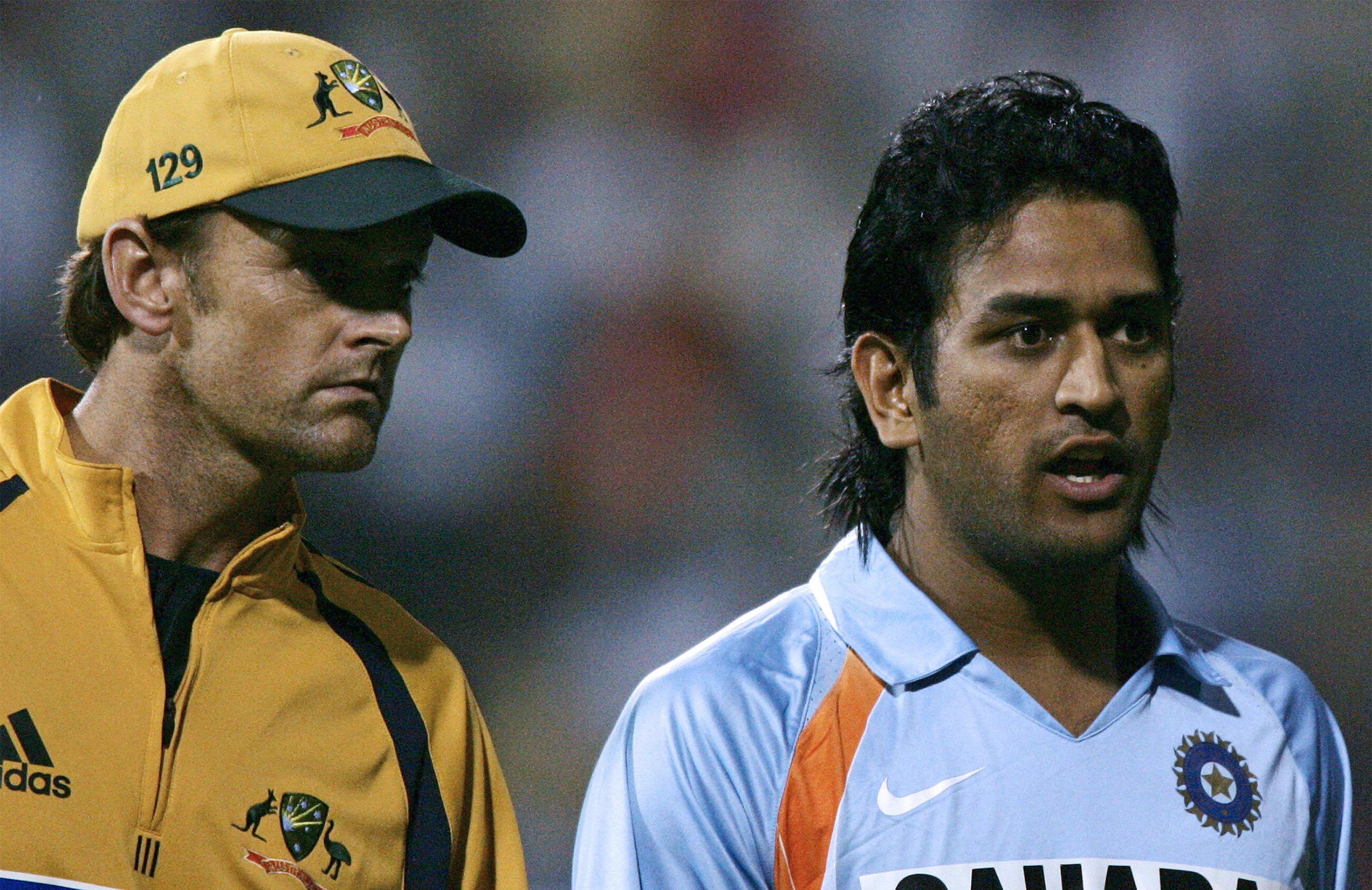 Look at the hair! Gilchirst and Dhoni in 2007 // Getty