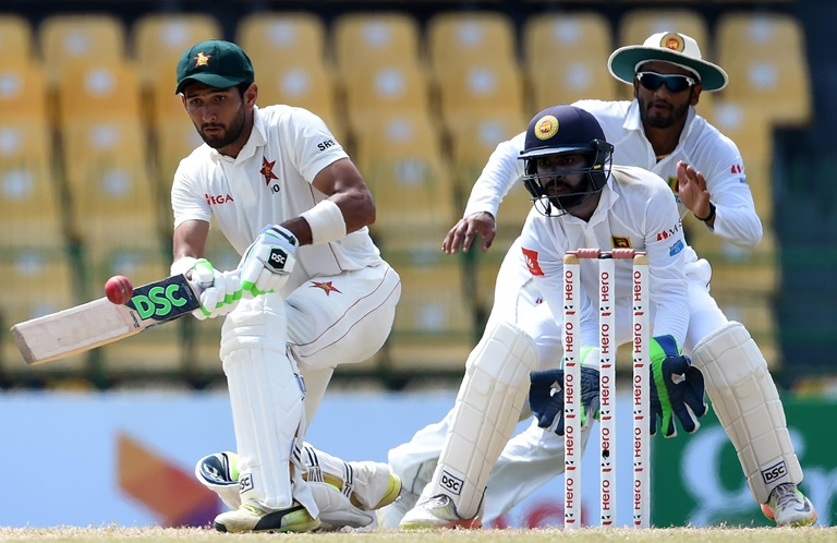 Zimbabwe-recover-after-Herath-spins-a-web-still