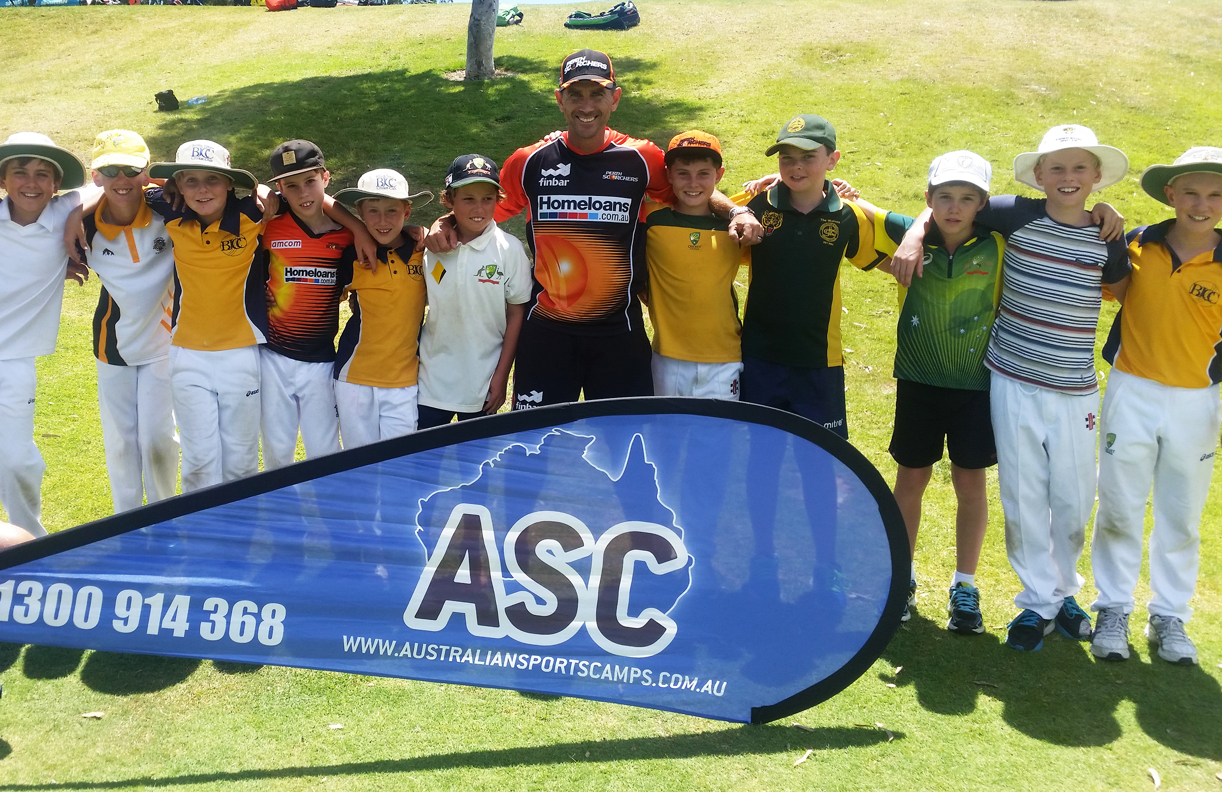 Justin Langer with some of the eager kids