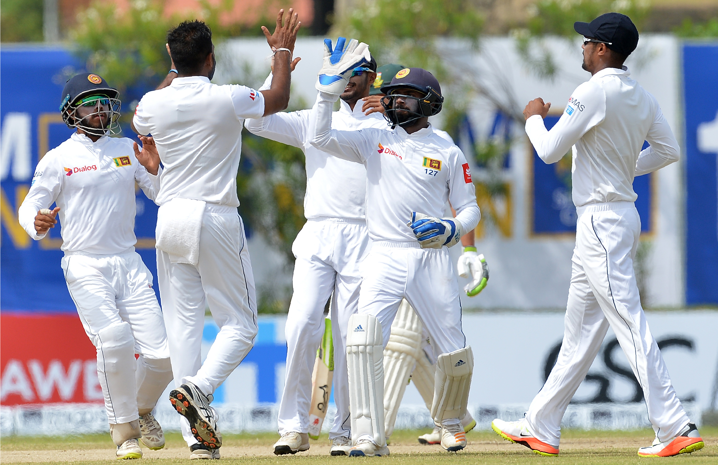 Sri Lanka players celebrate a wicket / Getty Images    