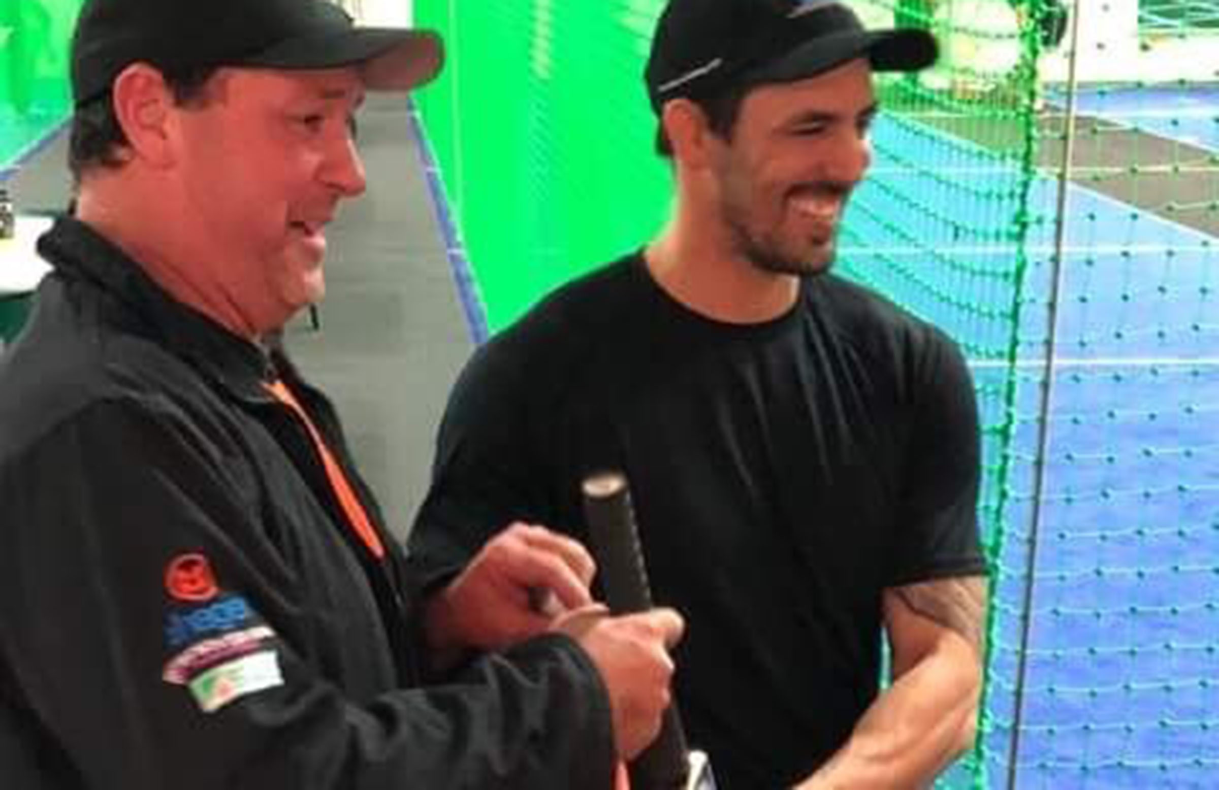 Johnson signs a bat at the Indoor centre