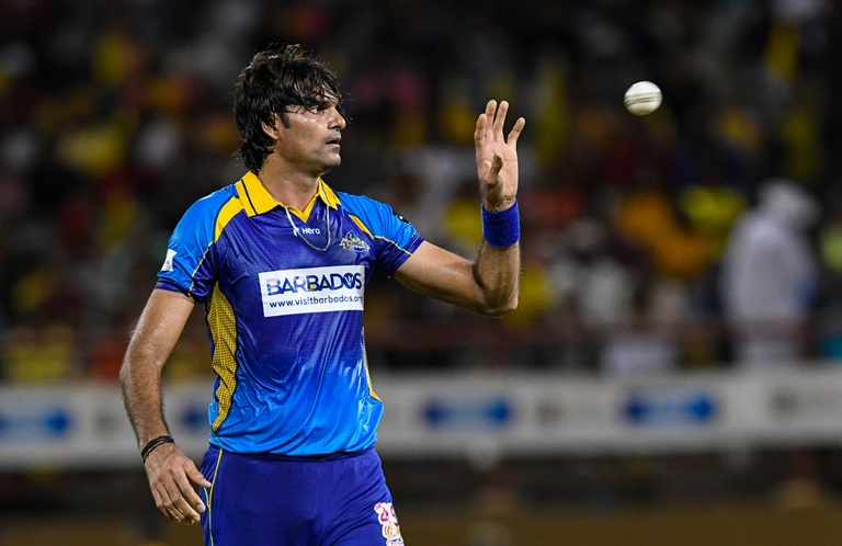 Mohammad Irfan bowled the most economical four overs spell in T20 history (photo - cricket.com.au)