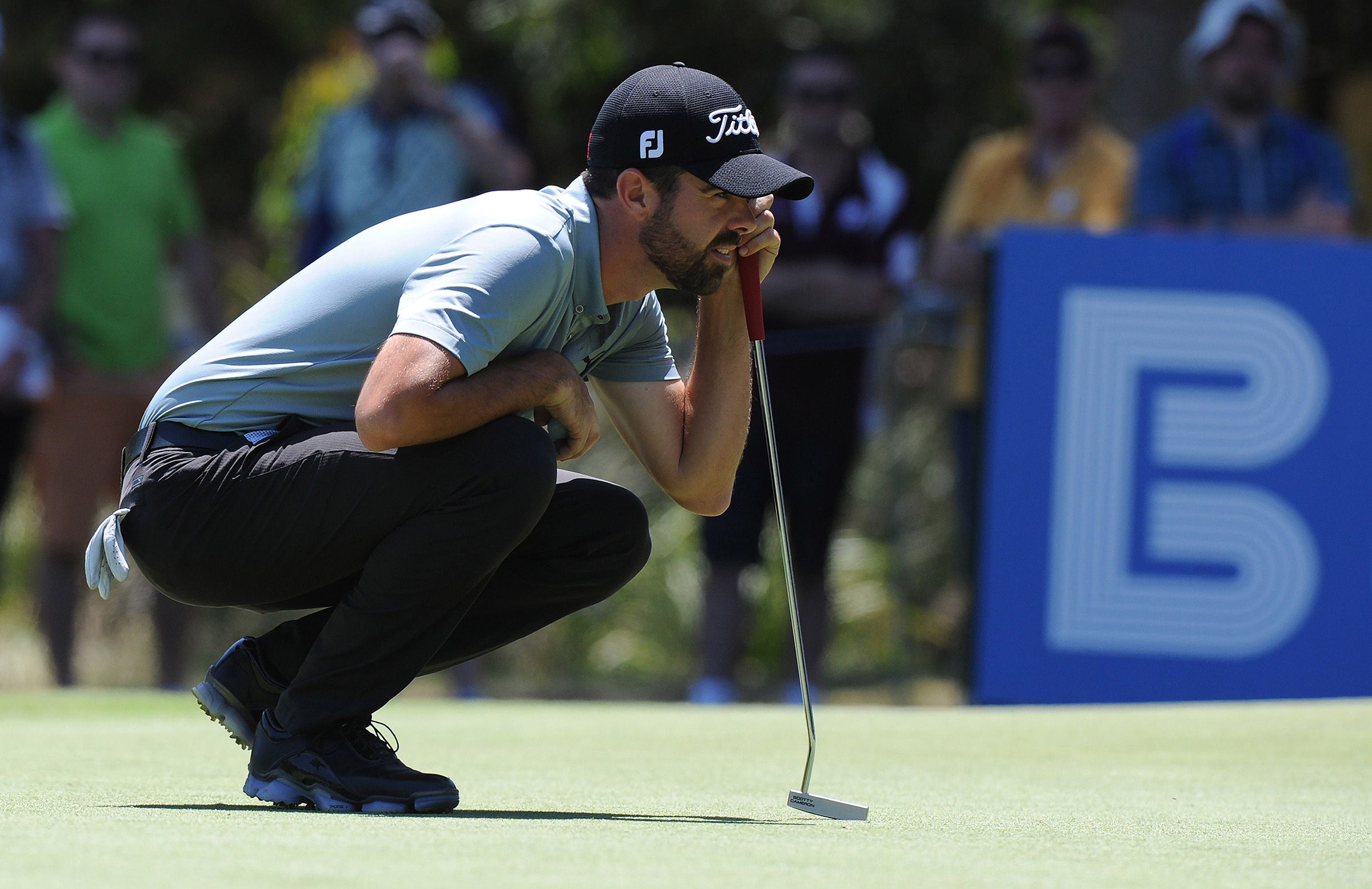 Nick Cullen lines up a putt during his 2014 Australian Open win // Getty
