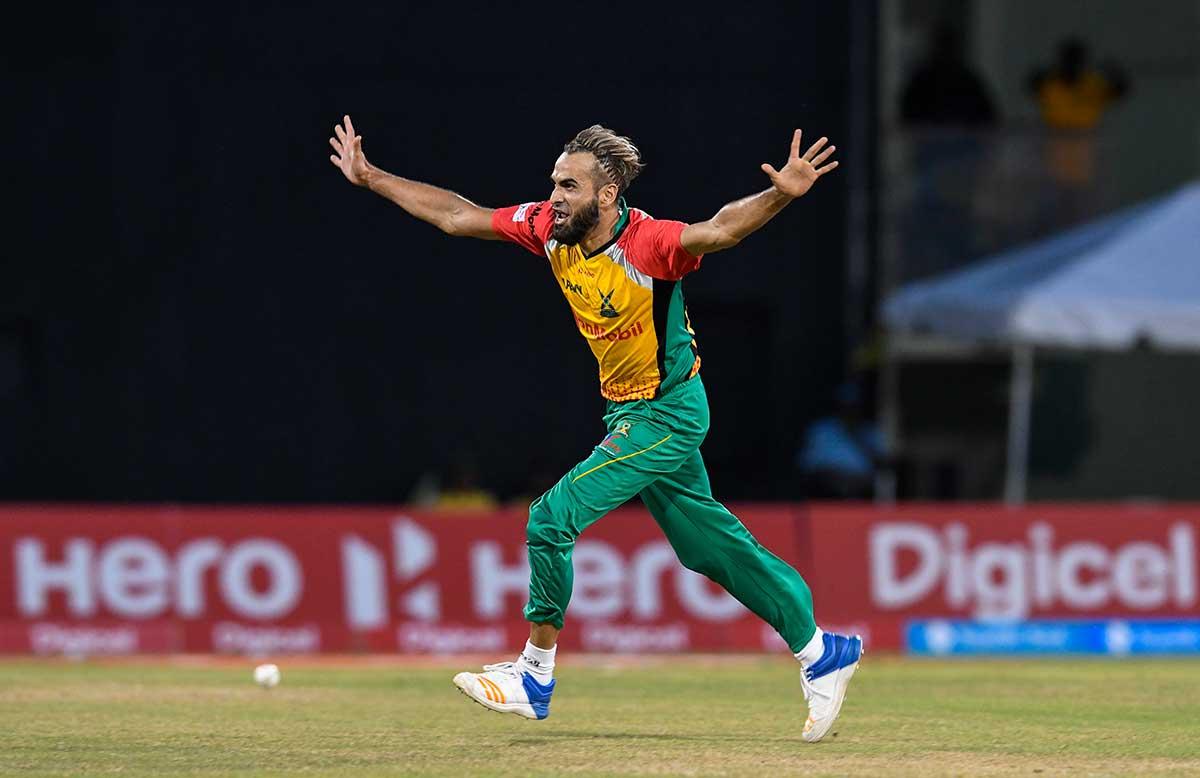 Tahir celebrates Warner's wicket // Getty
