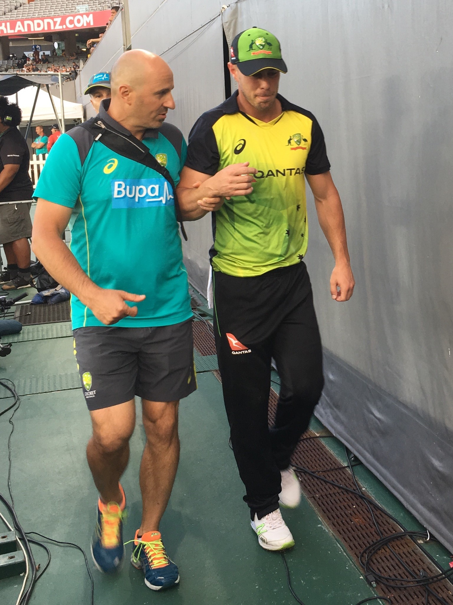 Lynn leaves the field with physio Alex Kountouris // cricket.com.au