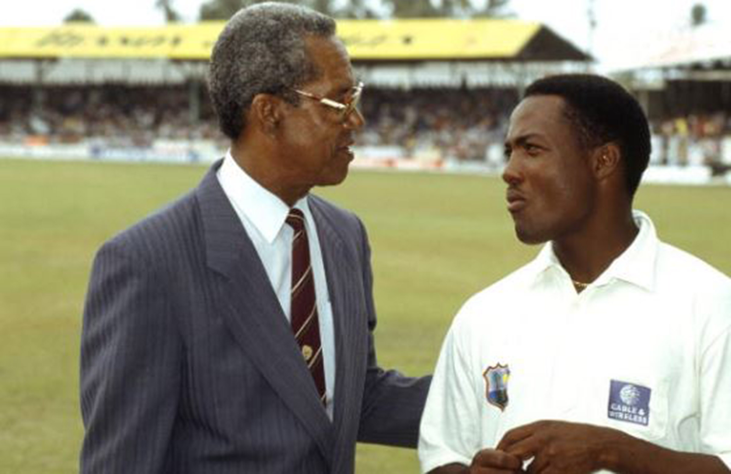 Sobers hands the world record baton to a young Lara in April 1994 // Getty