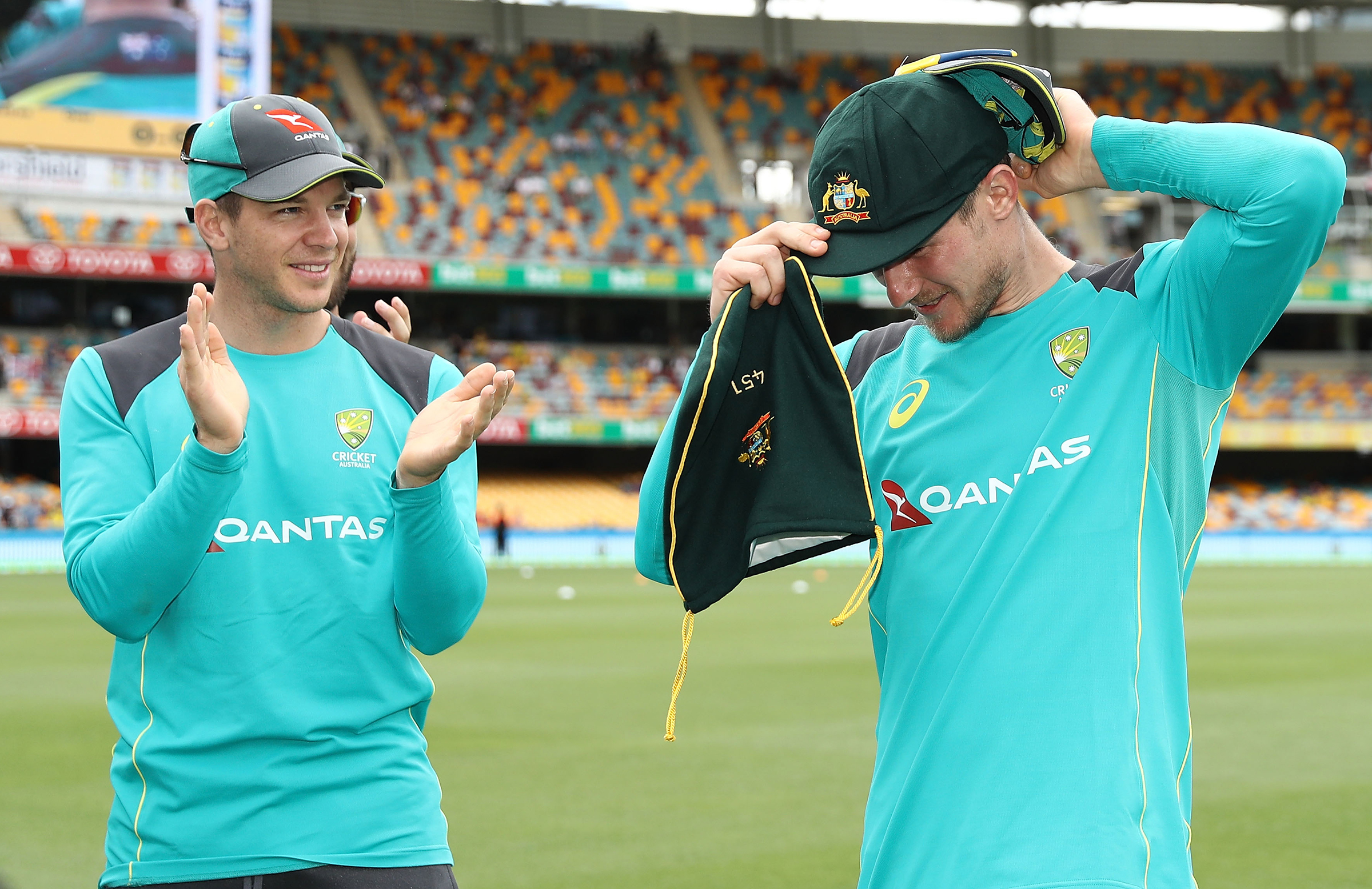 Bancroft (r) receives his Baggy Green as Paine (l) watches on // Getty