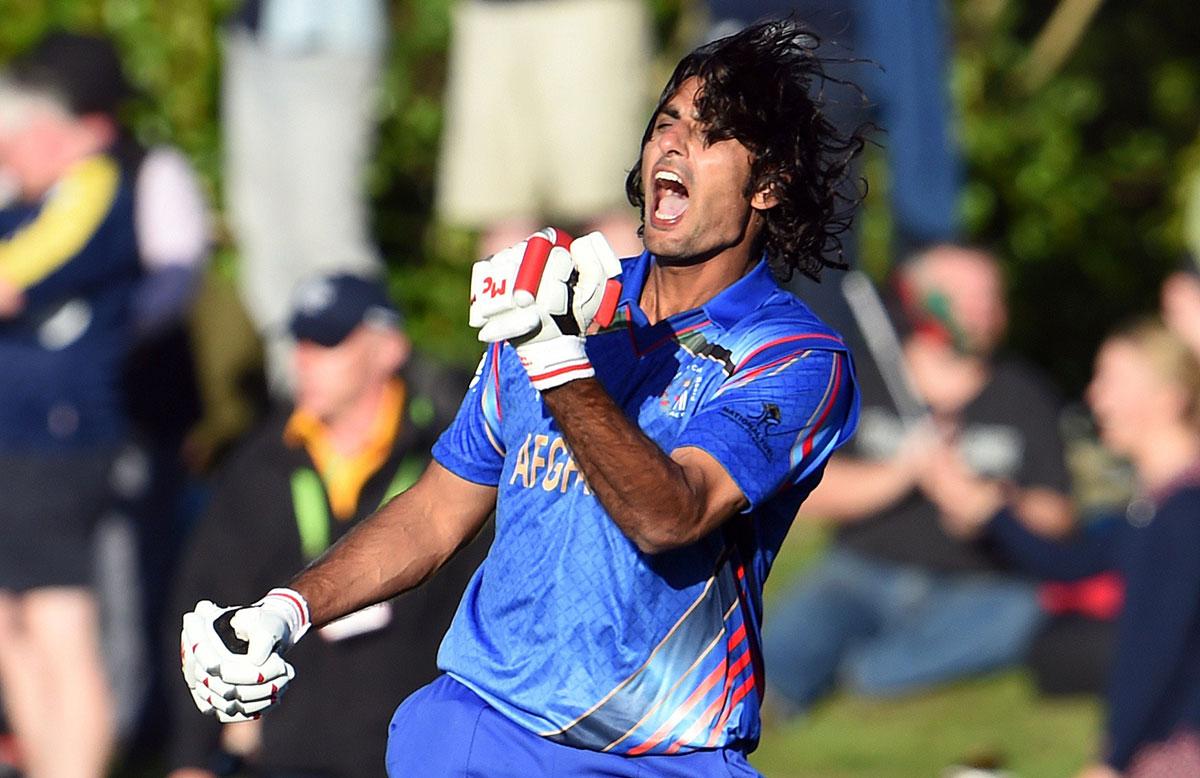 Afghanistan batsman Shapoor Zadran celebrates after hitting the winning runs // Getty Images