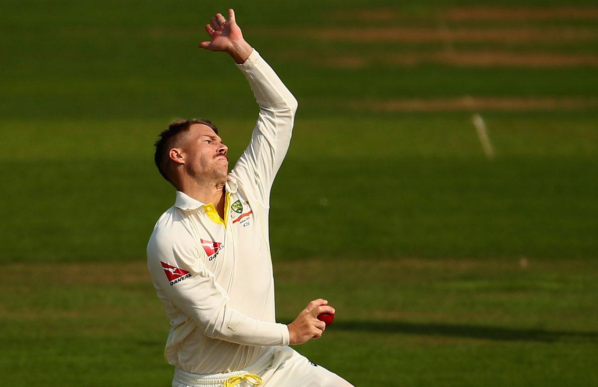 David Warner bowling // Getty Images