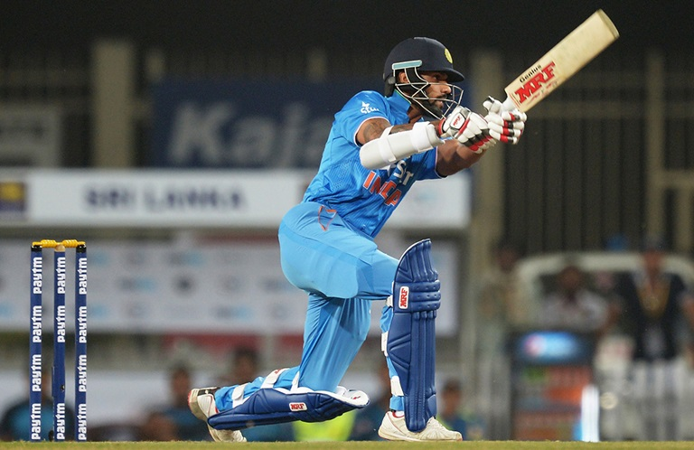 India's Shikhar Dhawan made his maiden T20 international half-century // Getty