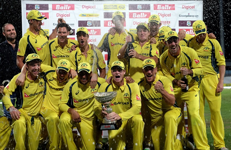 Australia celebrate with the tri-series cup // Getty Images