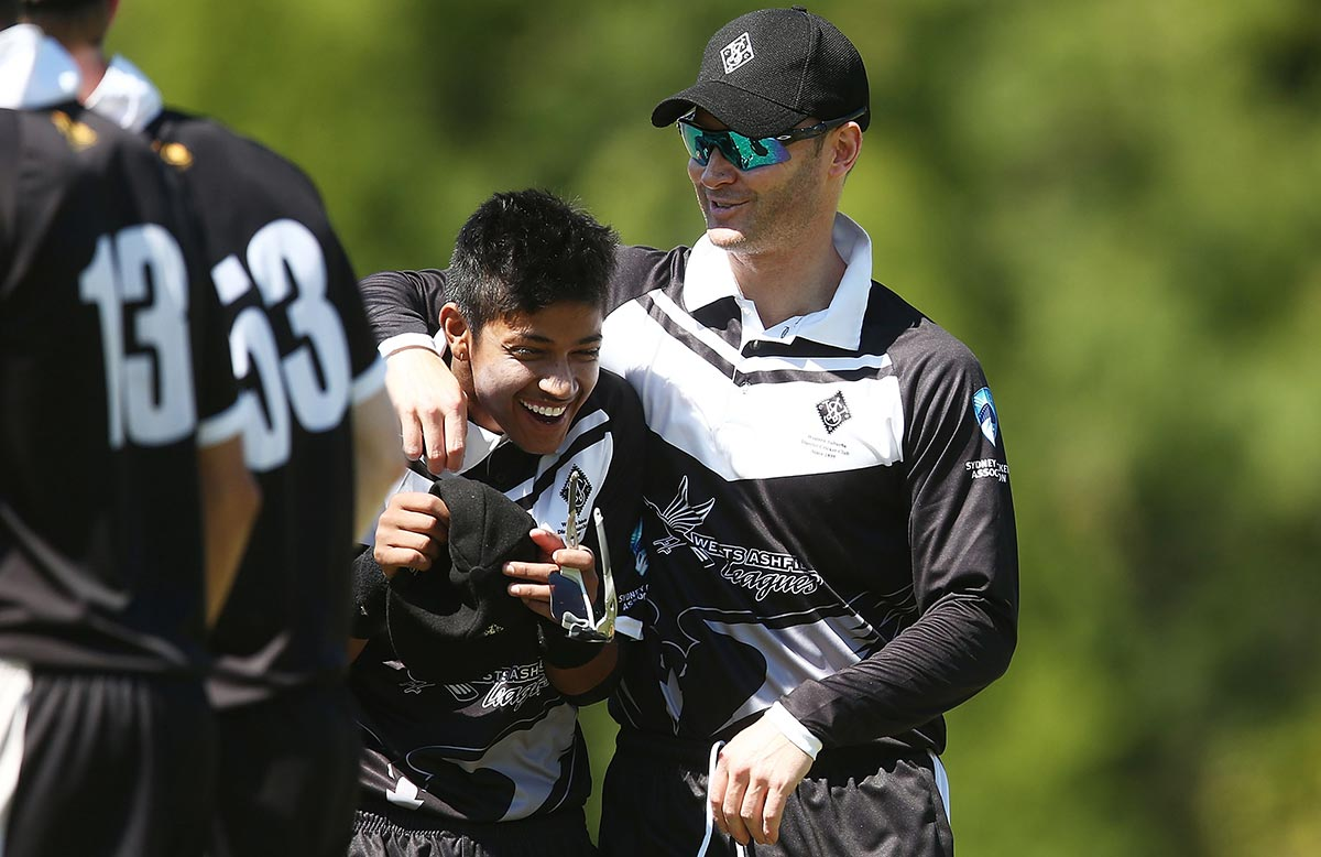 Clarke with Lamichhane at Allan Border Oval // Getty Images