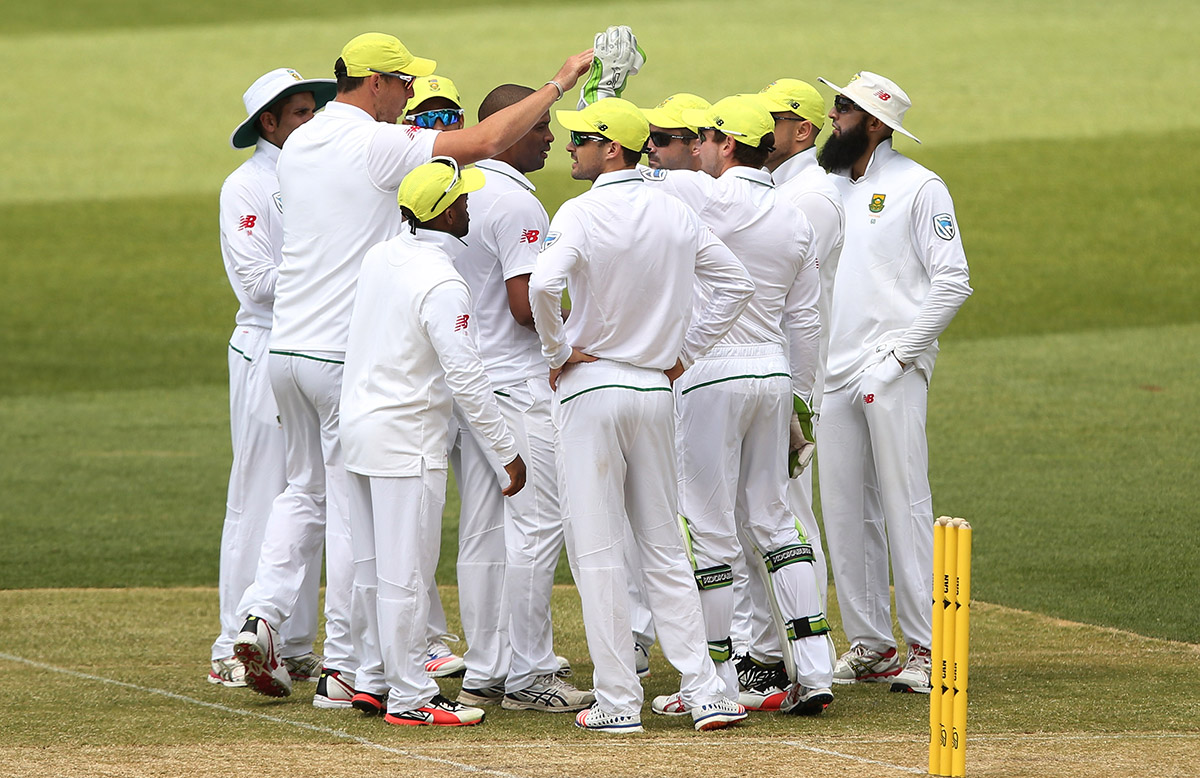 Harry Nielsen in the centre of a South African huddle after one of his four catches // Getty