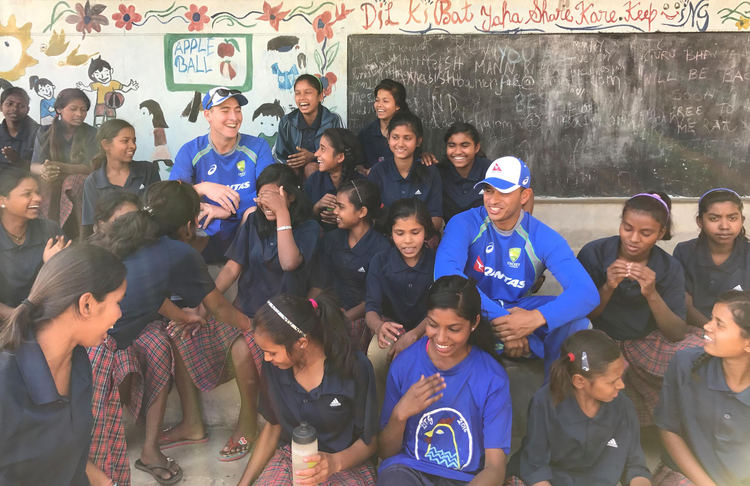 Matt Renshaw and Usman Khawaja meets with the Yuwa girls // cricket.com.au