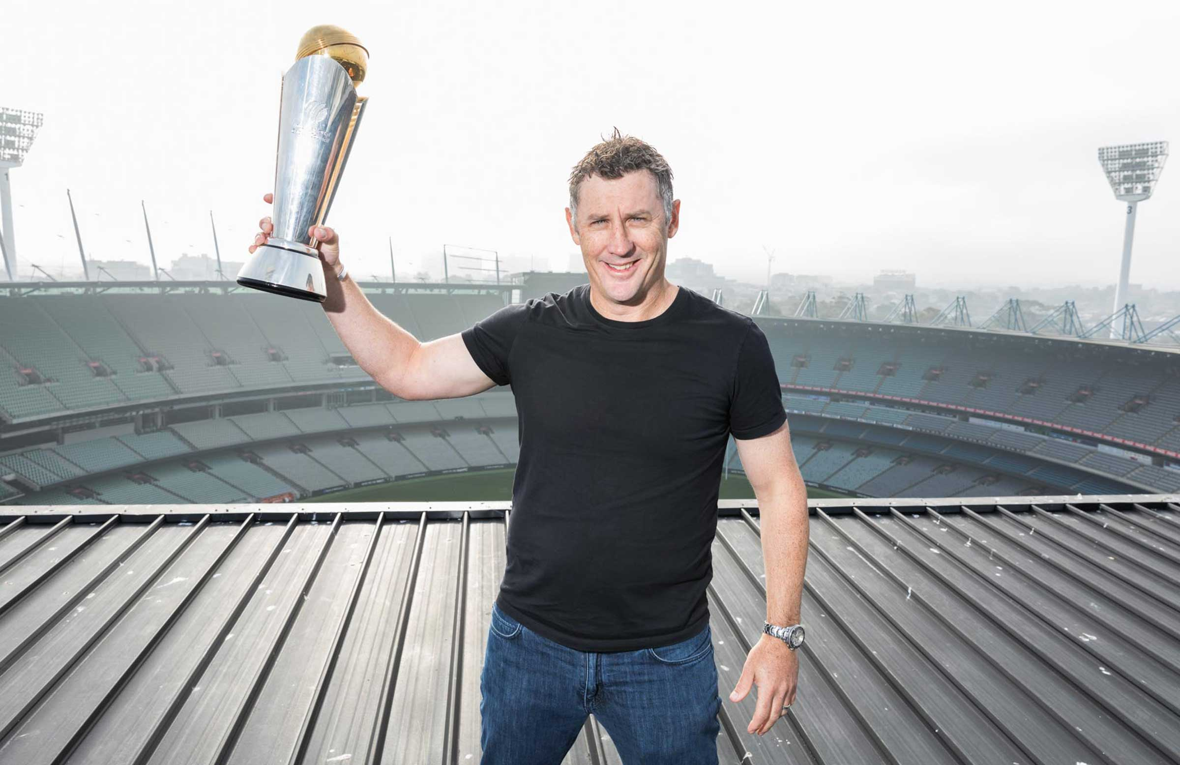 David Hussey takes the Champions Trophy onto the roof of the MCG // ICC