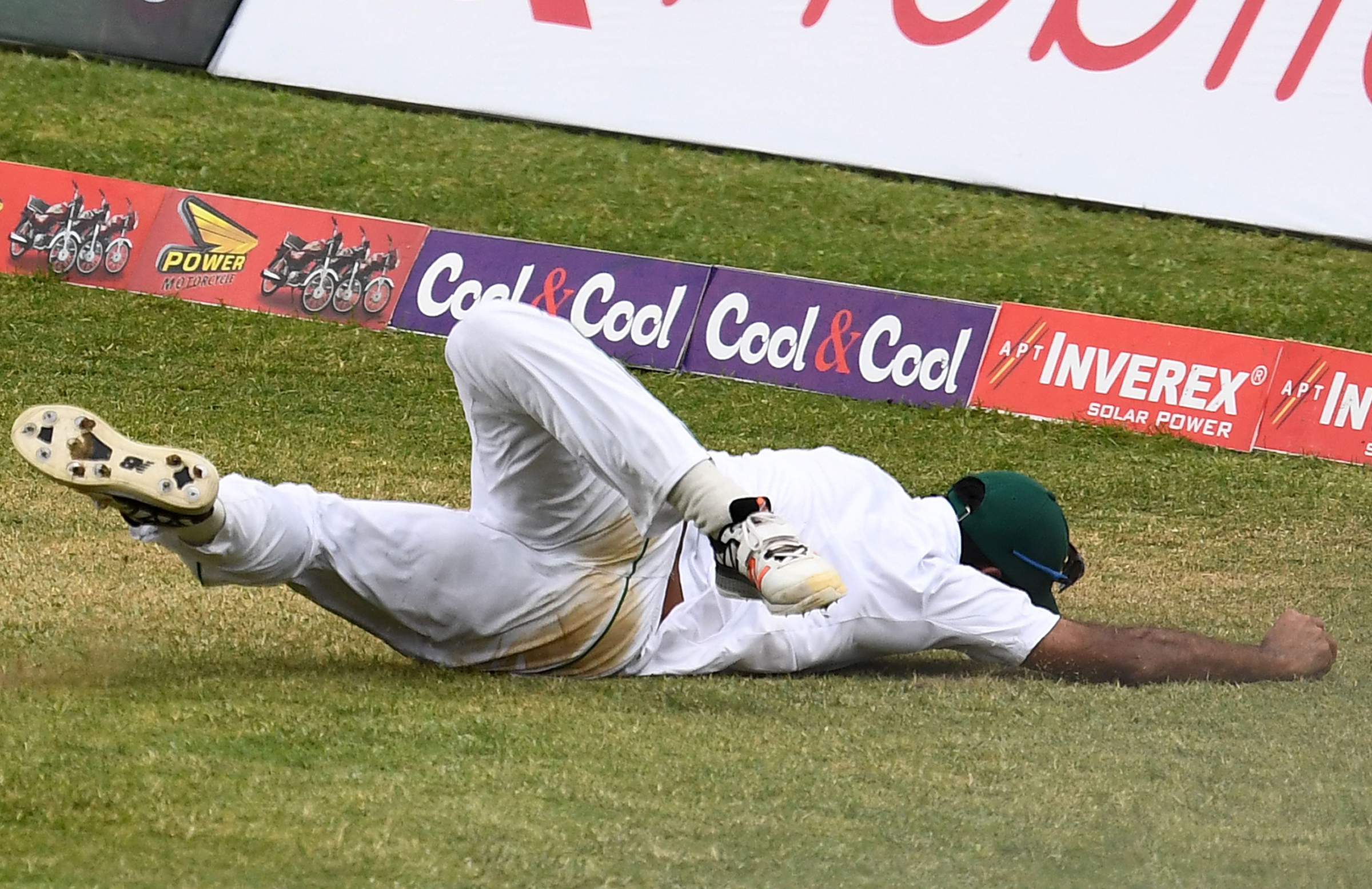 Wahab clings on to a superb diving catch // Getty