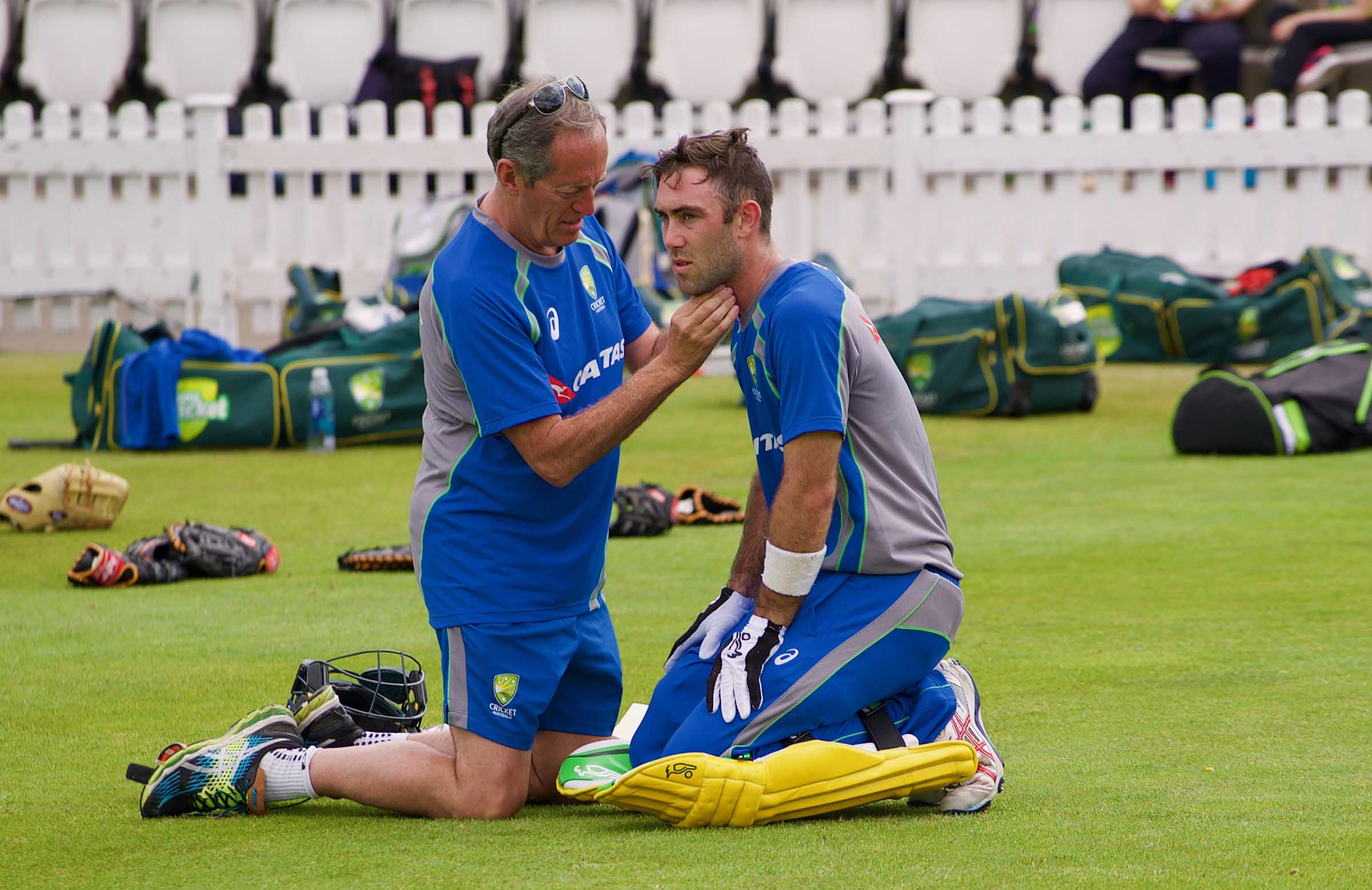 Dr Brukner treats Maxwell after he was struck // cricket.com.au