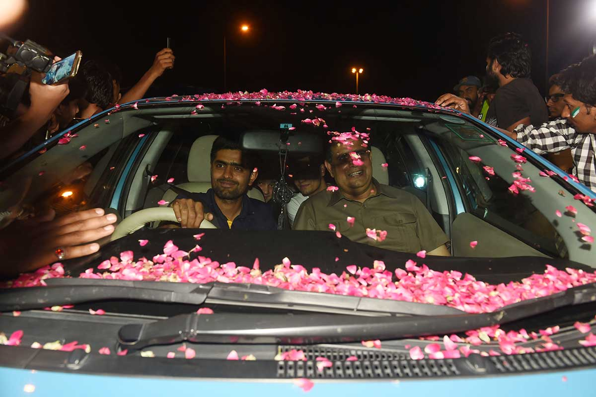 Babar Azam is showered with petals as he leaves the airport // Getty