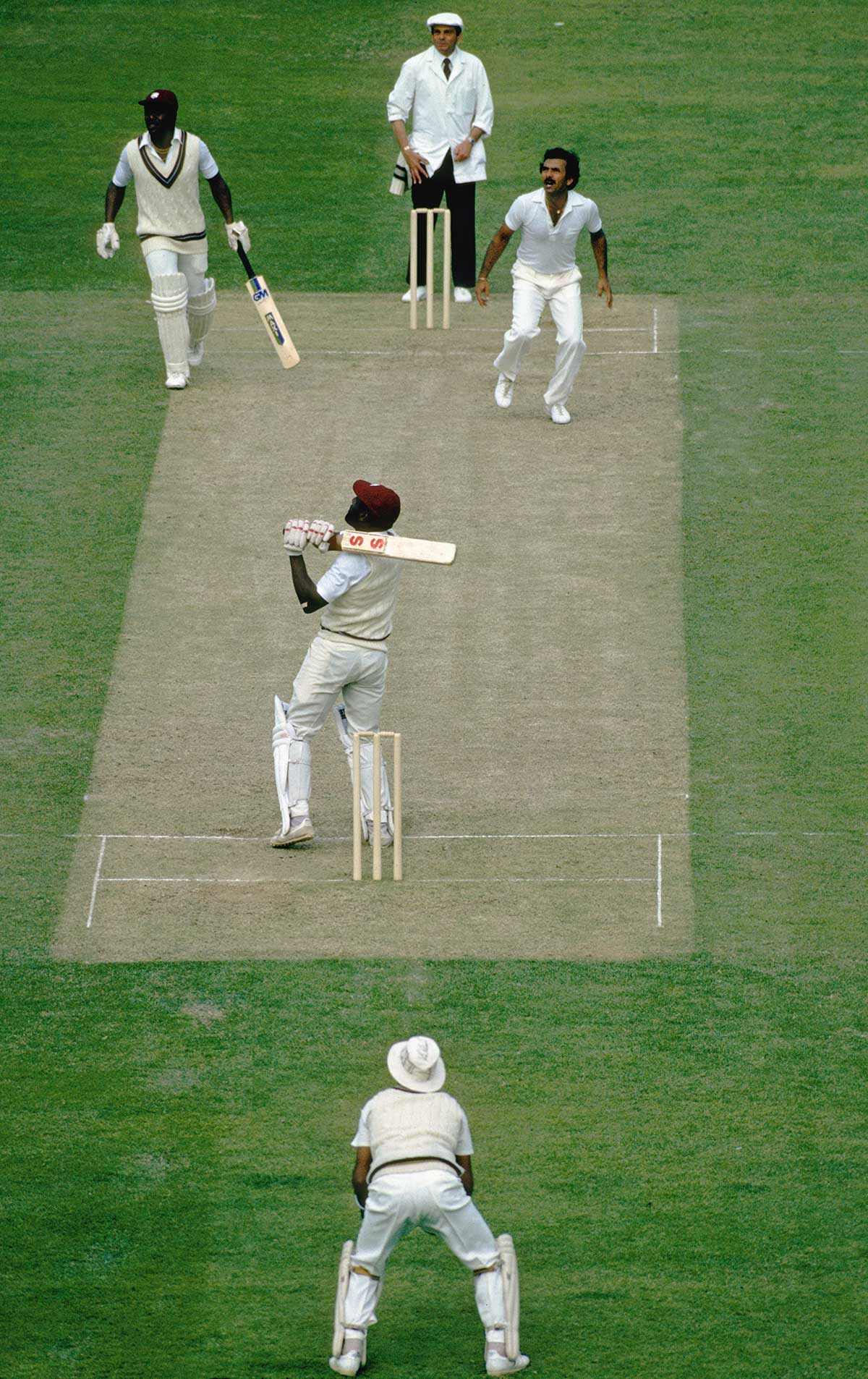 Richards sends the ball from Madan Lal high for Dev to catch // Getty