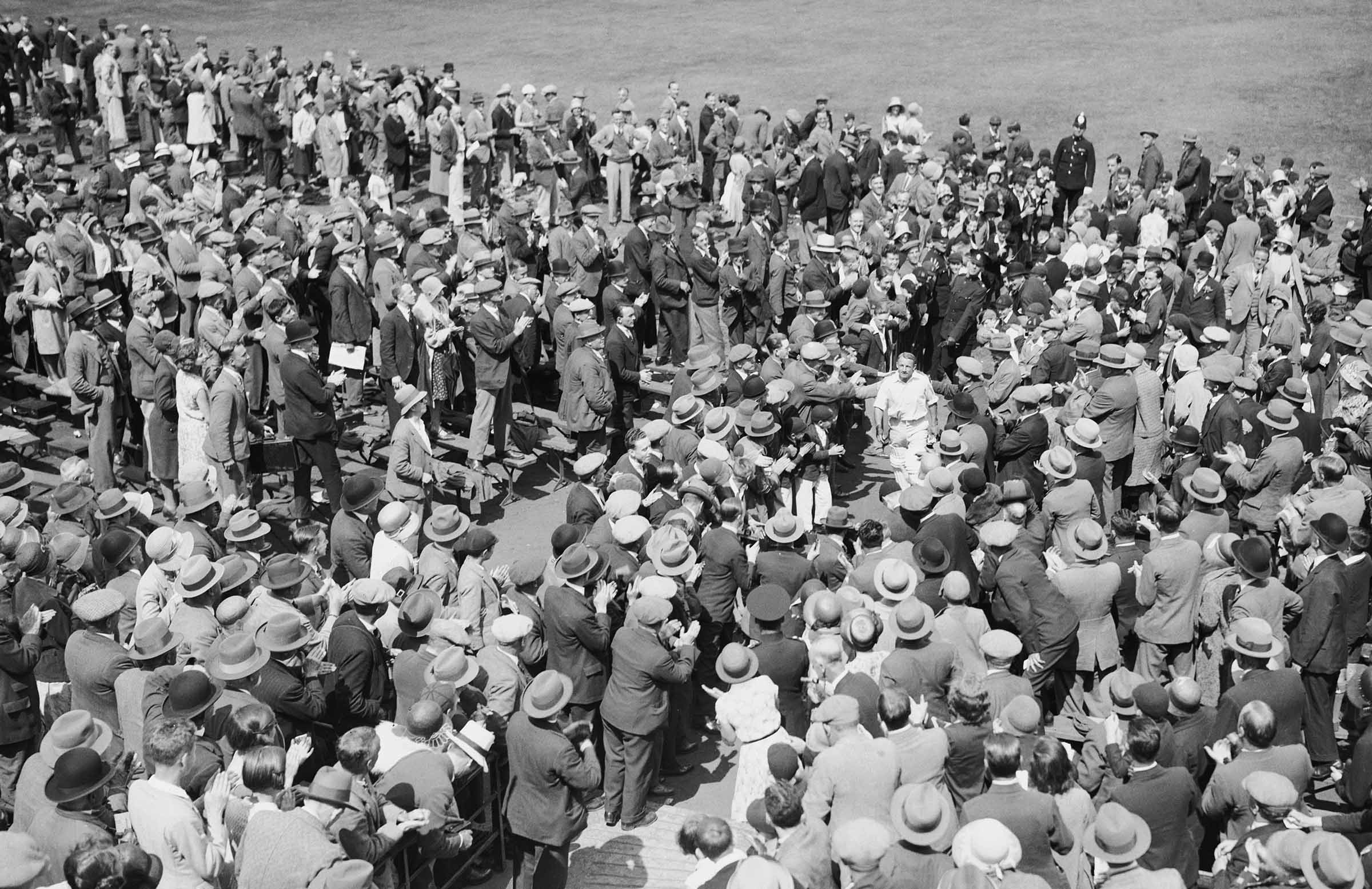 Bradman is engulfed after his first Test triple ton // Getty