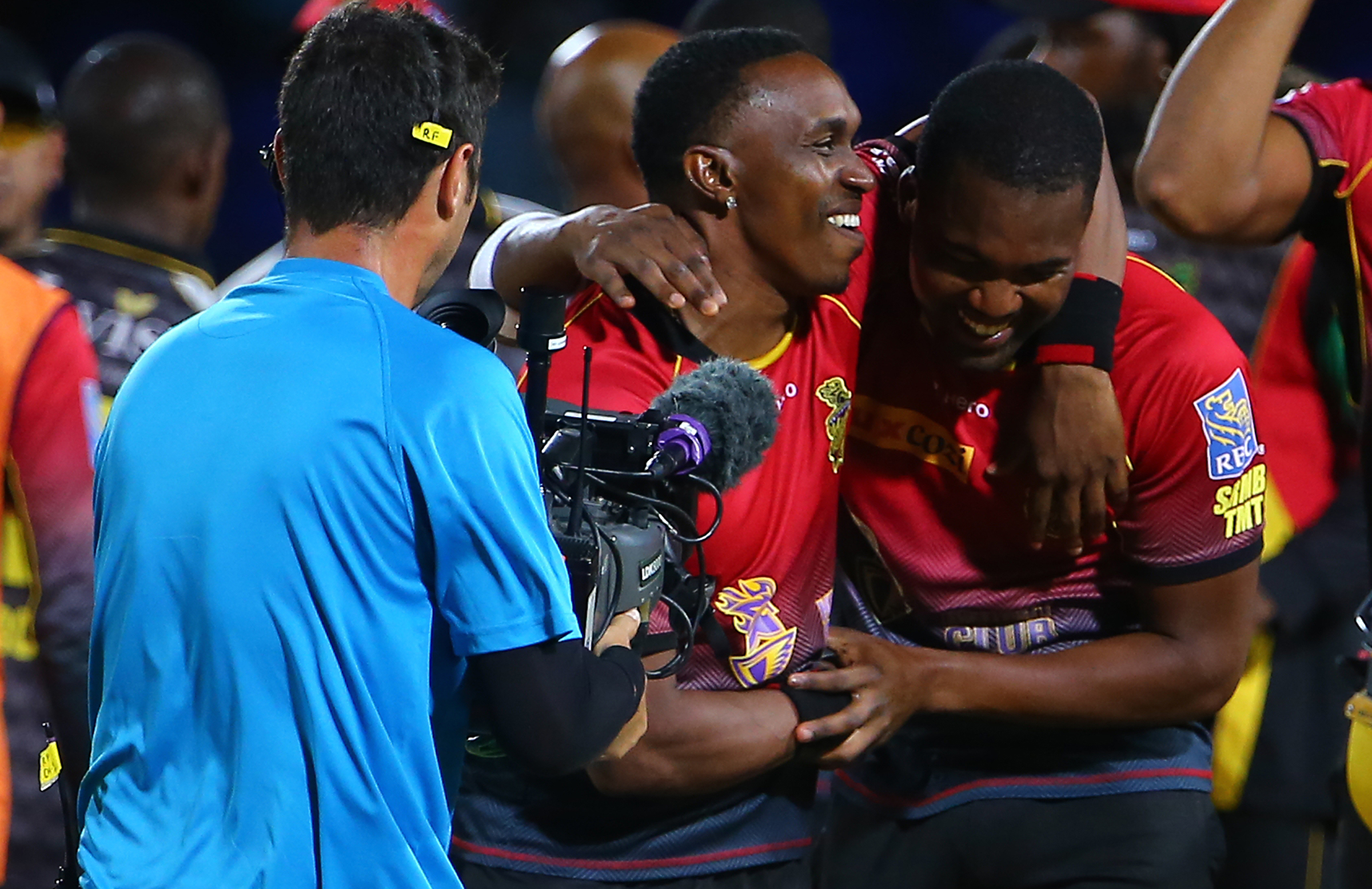 Darren Bravo and his half brother Dwayne celebrate the incredible win // Getty