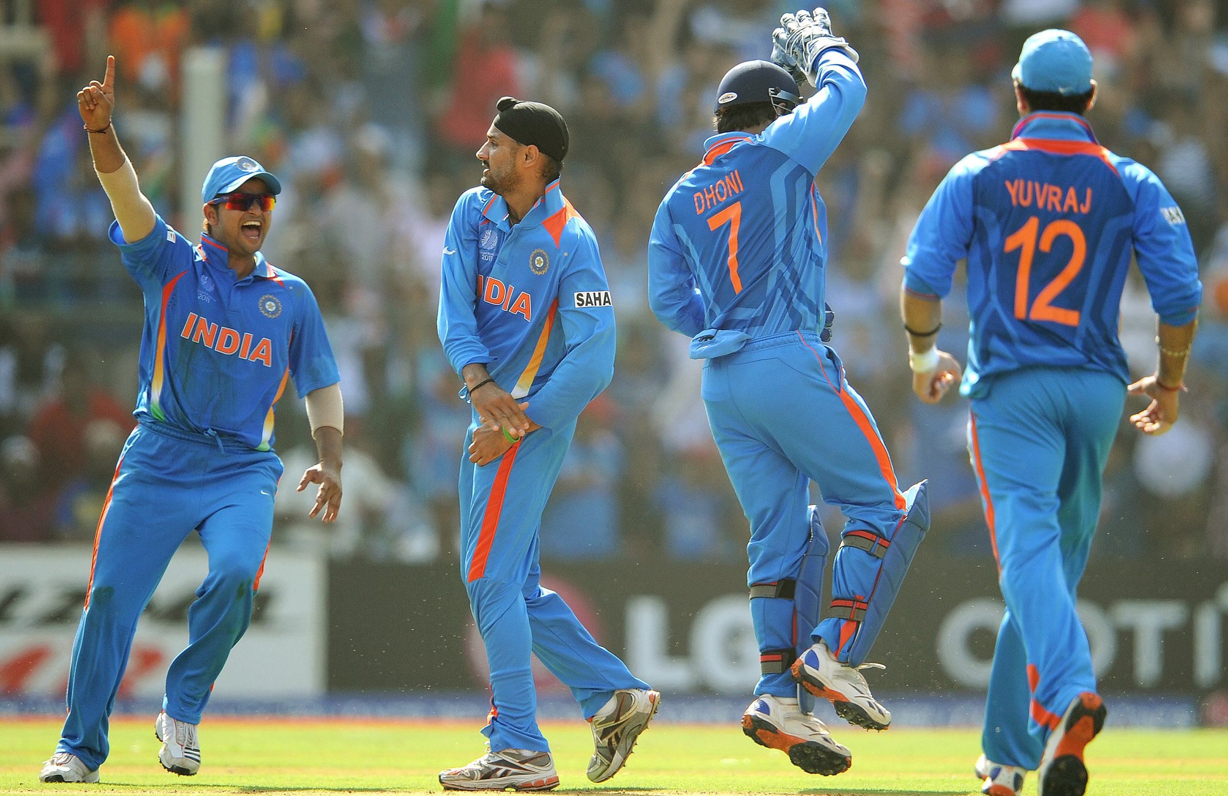 Raina, Harbhajan Singh, Dhoni and Yuvraj at the 2011 World Cup // Getty