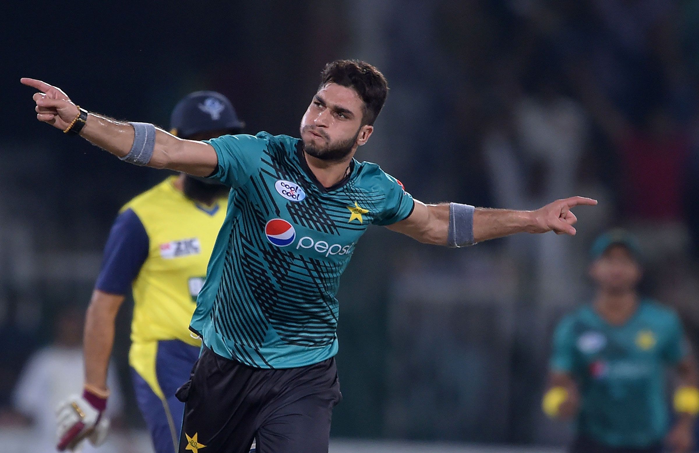 Usman Khan Shinwari celebrates after taking the wicket of World XI batsman Tamim Iqbal // Getty