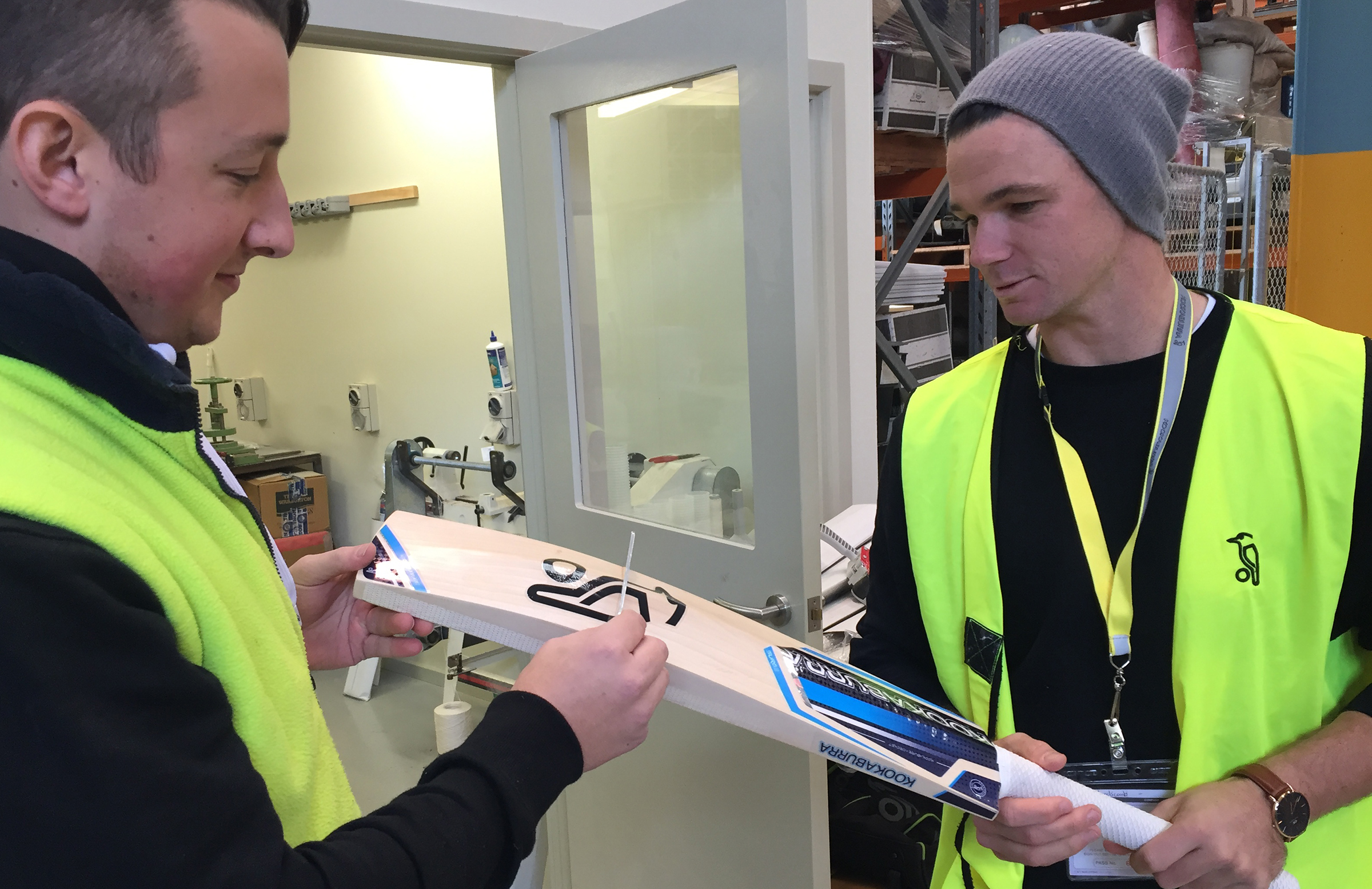 Dinger running the bat gauge over one of Handscomb's new sticks // Kookaburra