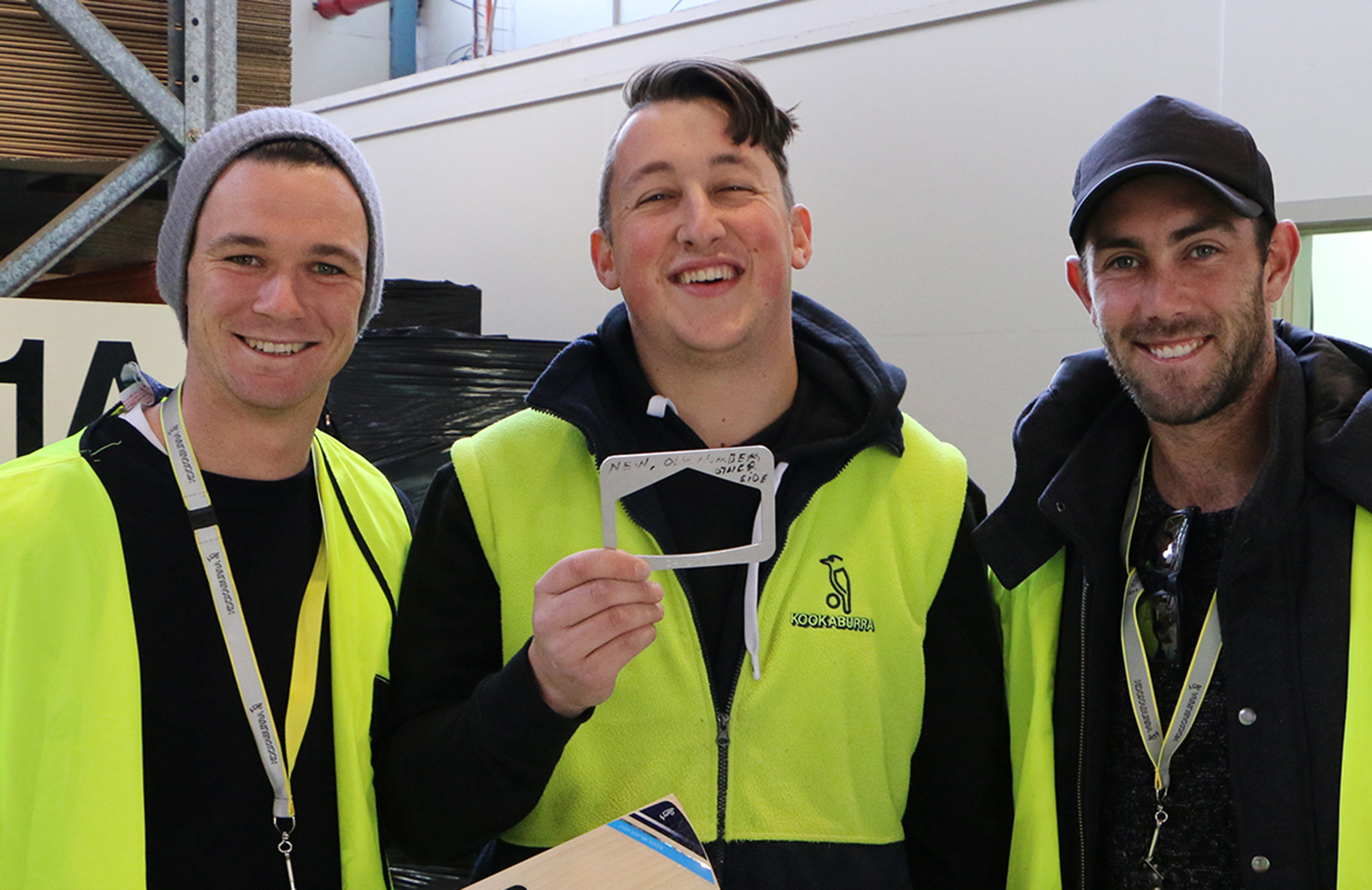 Handscomb (left) and Maxwell (right) with Kookaburra bat-maker Lachlan Dinger (centre) // Getty