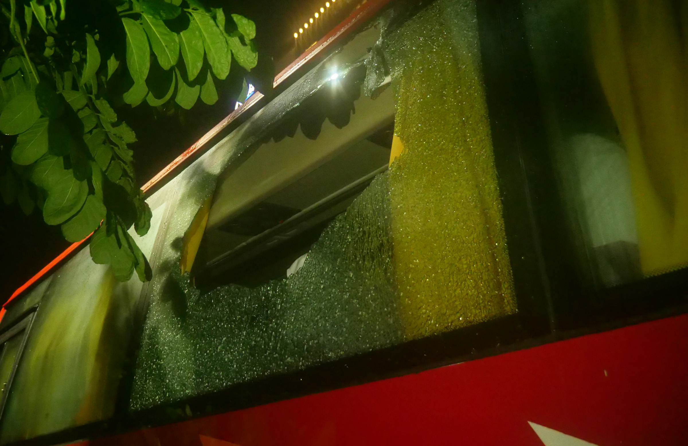 The damage to the Australian team's bus after a rock was thrown // cricket.com.au