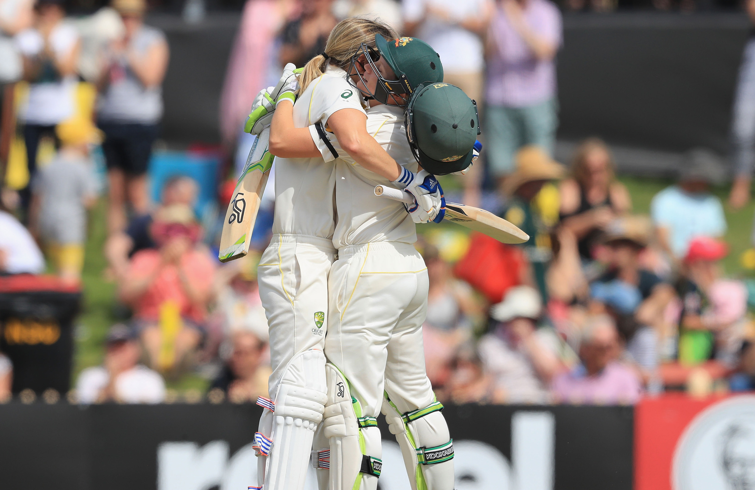 Perry celebrates her breakthrough century with teammate Alyssa Healy // Getty