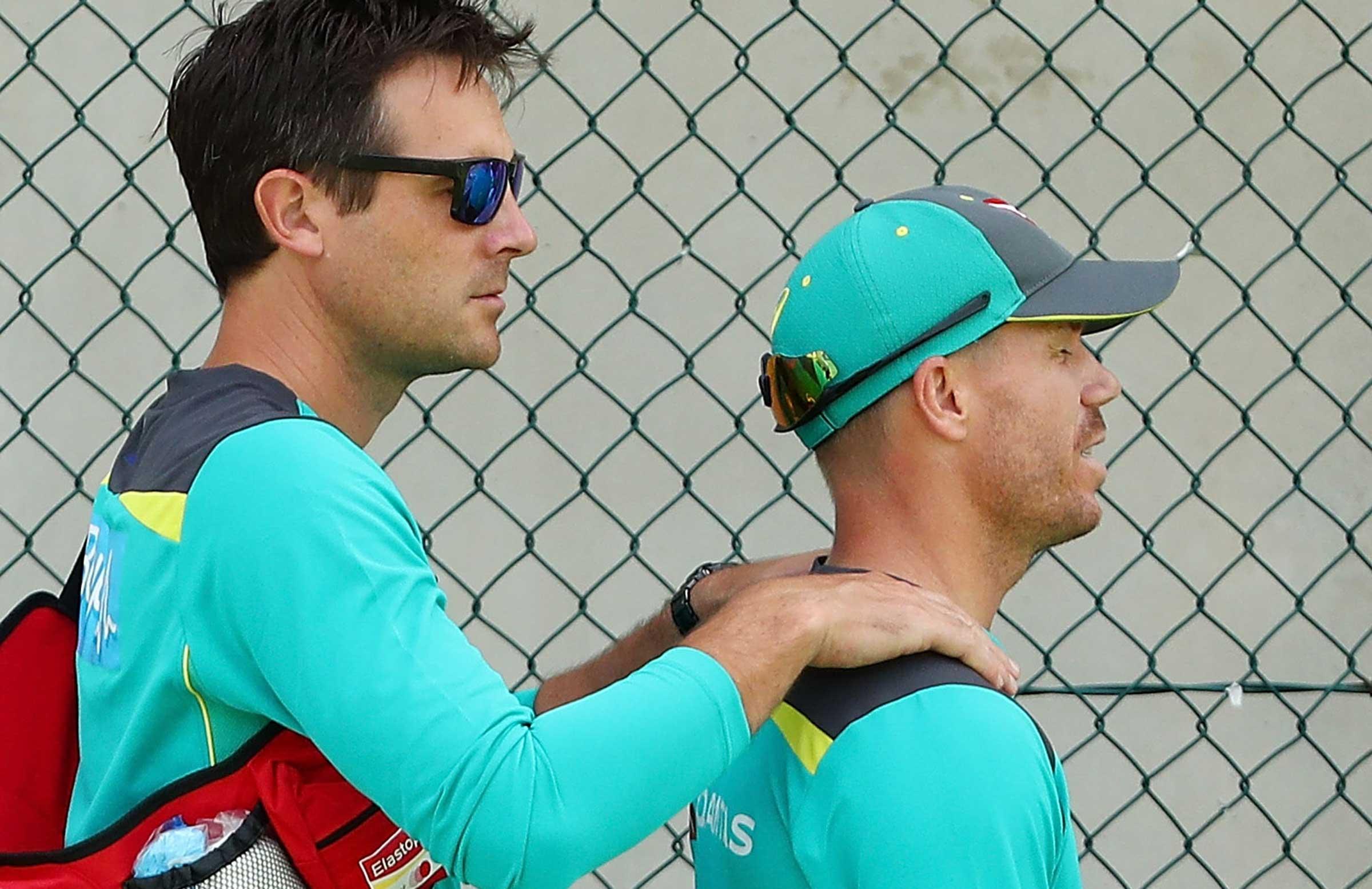 Physio David Beakley massages Warner's neck // Getty