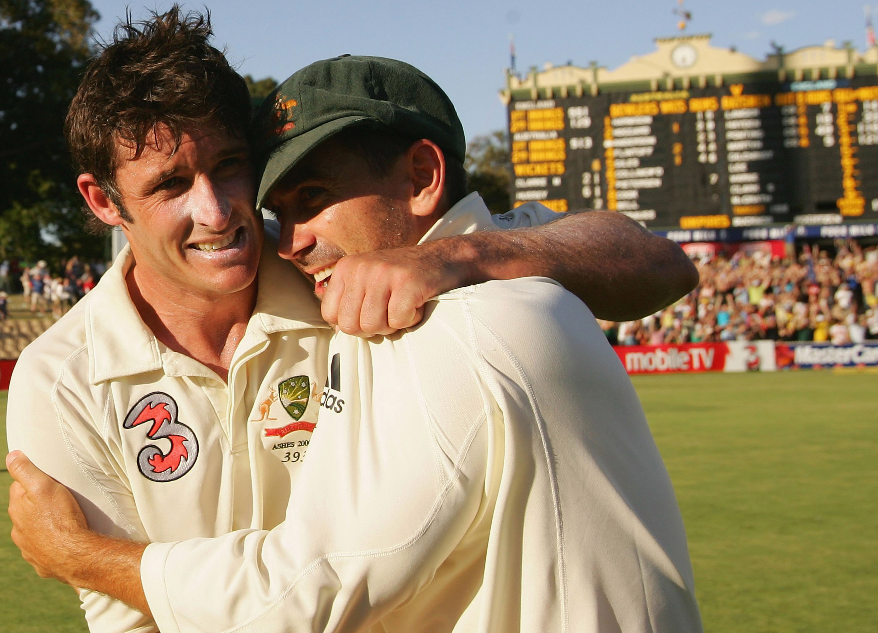 Mike Hussey celebrates Australia's famous victory in Adelaide with Justin Langer // Getty