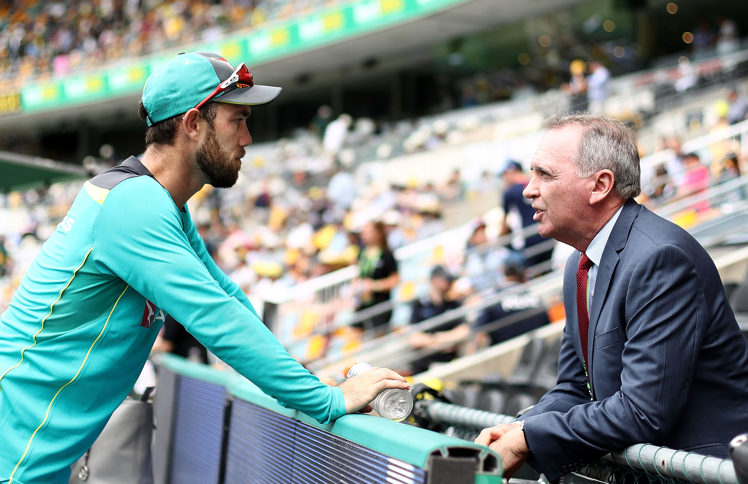 Maxwell and Hohns in discussion at the Gabba on Thursday // Getty