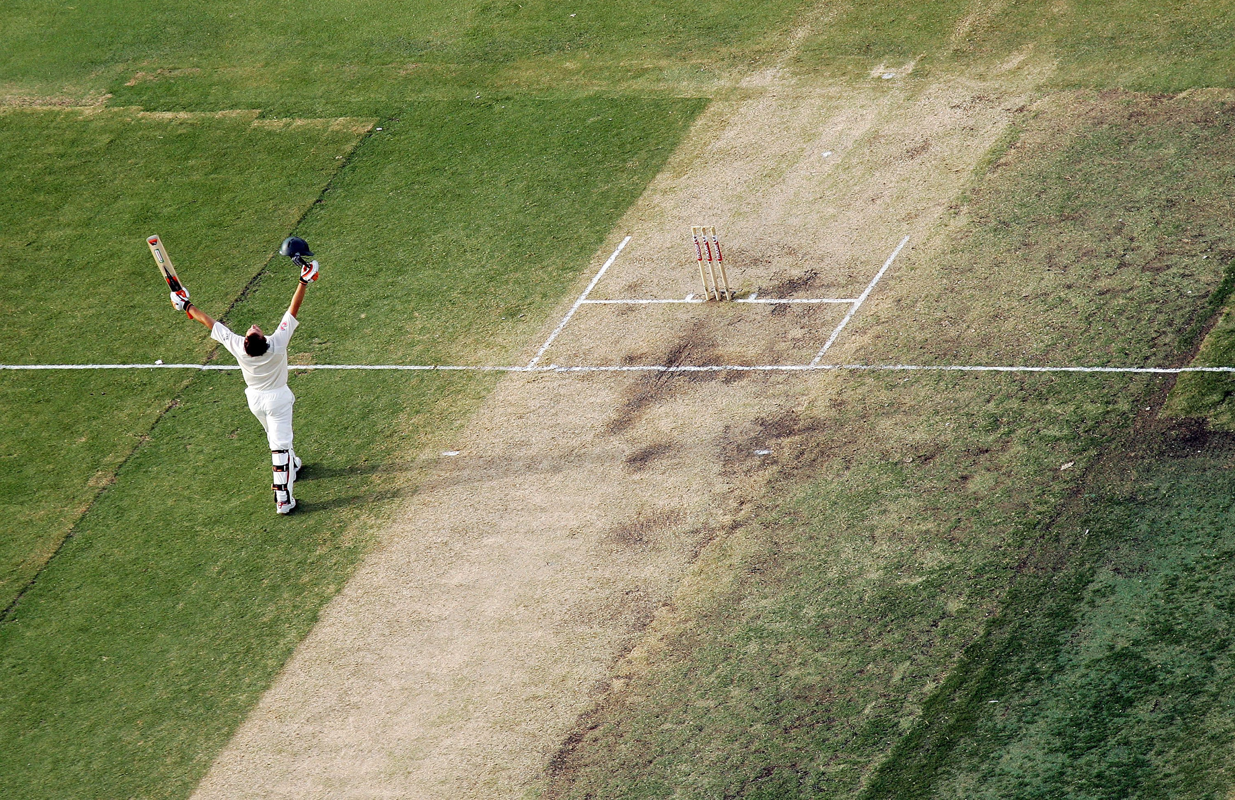 Gilchrist celebrates his record-breaking century in Perth // Getty