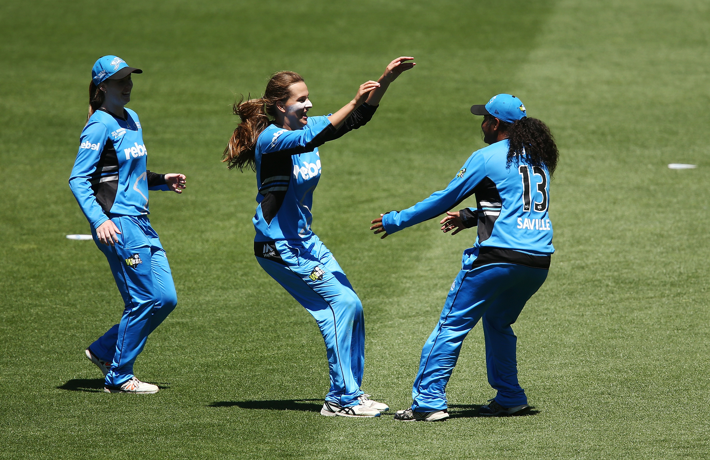 Alex Price (centre) celebrates the first WBBL catch of Saville (right) // Getty