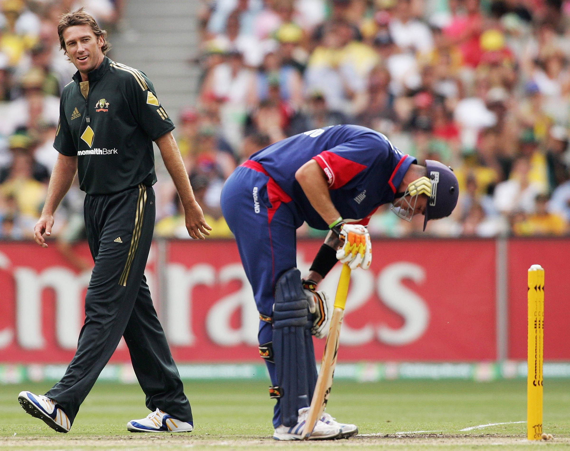 McGrath looks on as Pietersen doubles over in pain // Getty