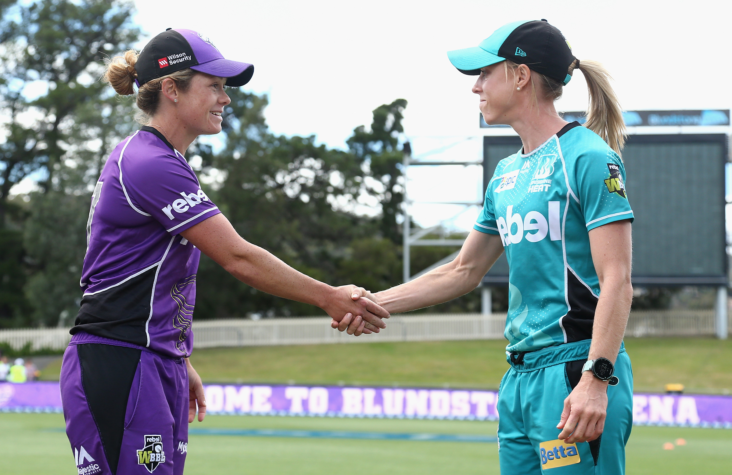 Hurricanes captain Corinne Hall (left) and Heat captain Kirby Short shake hands at a coin toss // Getty