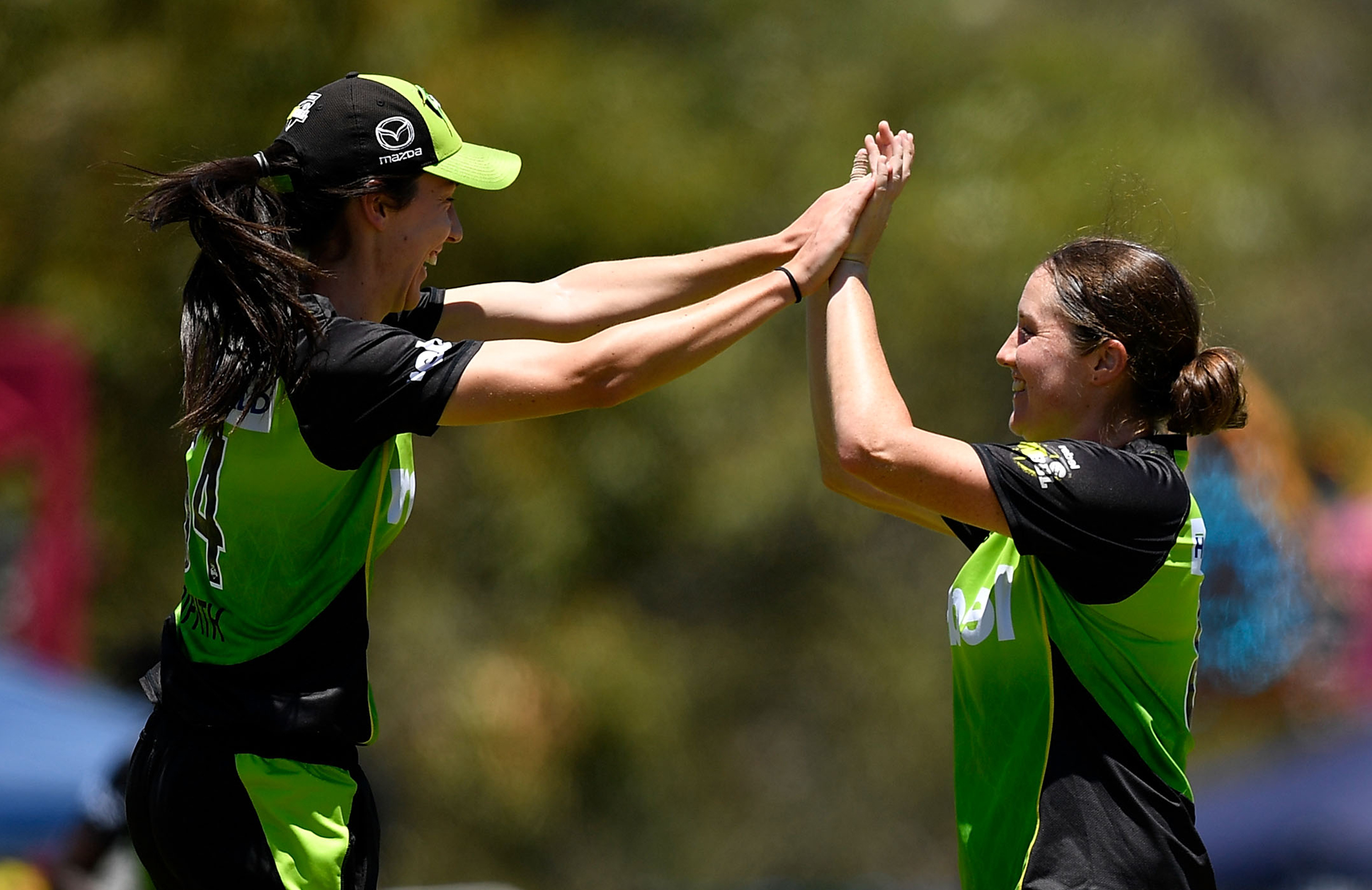 Lisa Griffith (left) celebrates a wicket with Thunder teammate Rene Farrell // Getty