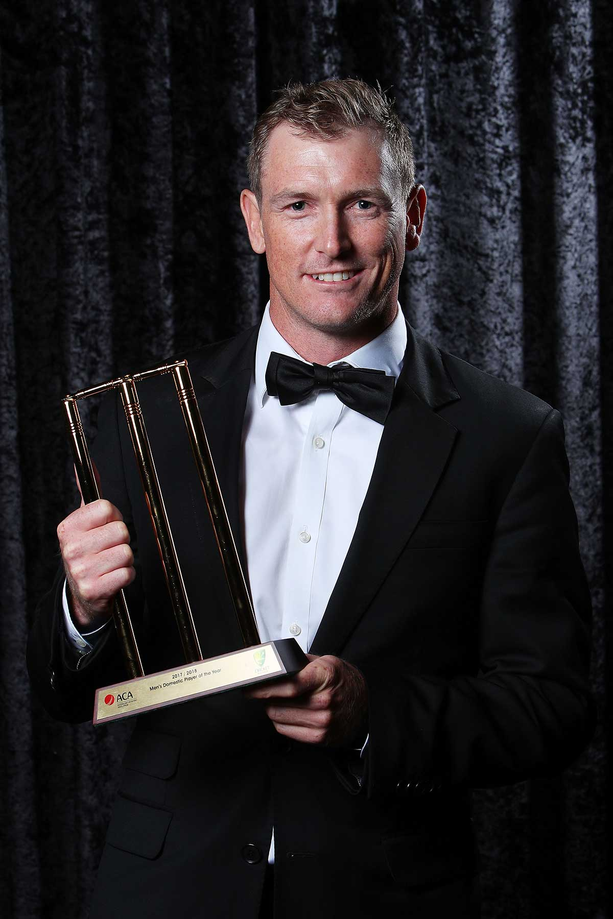 George Bailey with his trophy // Getty