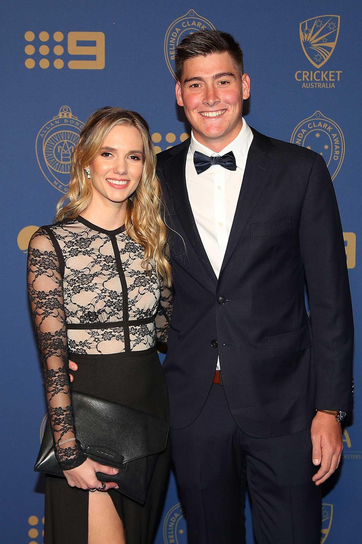 Queensland opener Matthew Renshaw and Josie Harvey // Getty