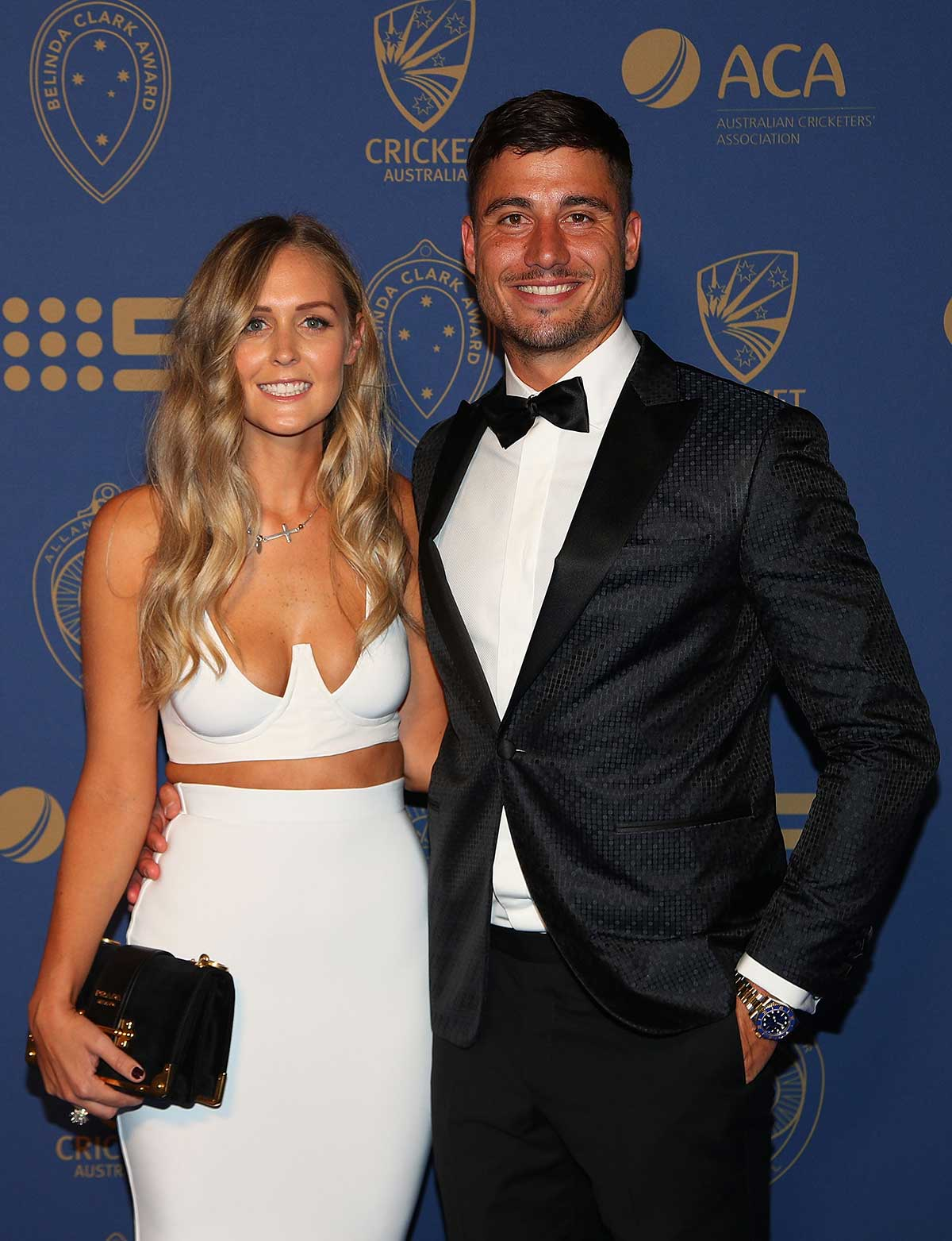 Marcus Stoinis and Stephanie Muller on the carpet // Getty