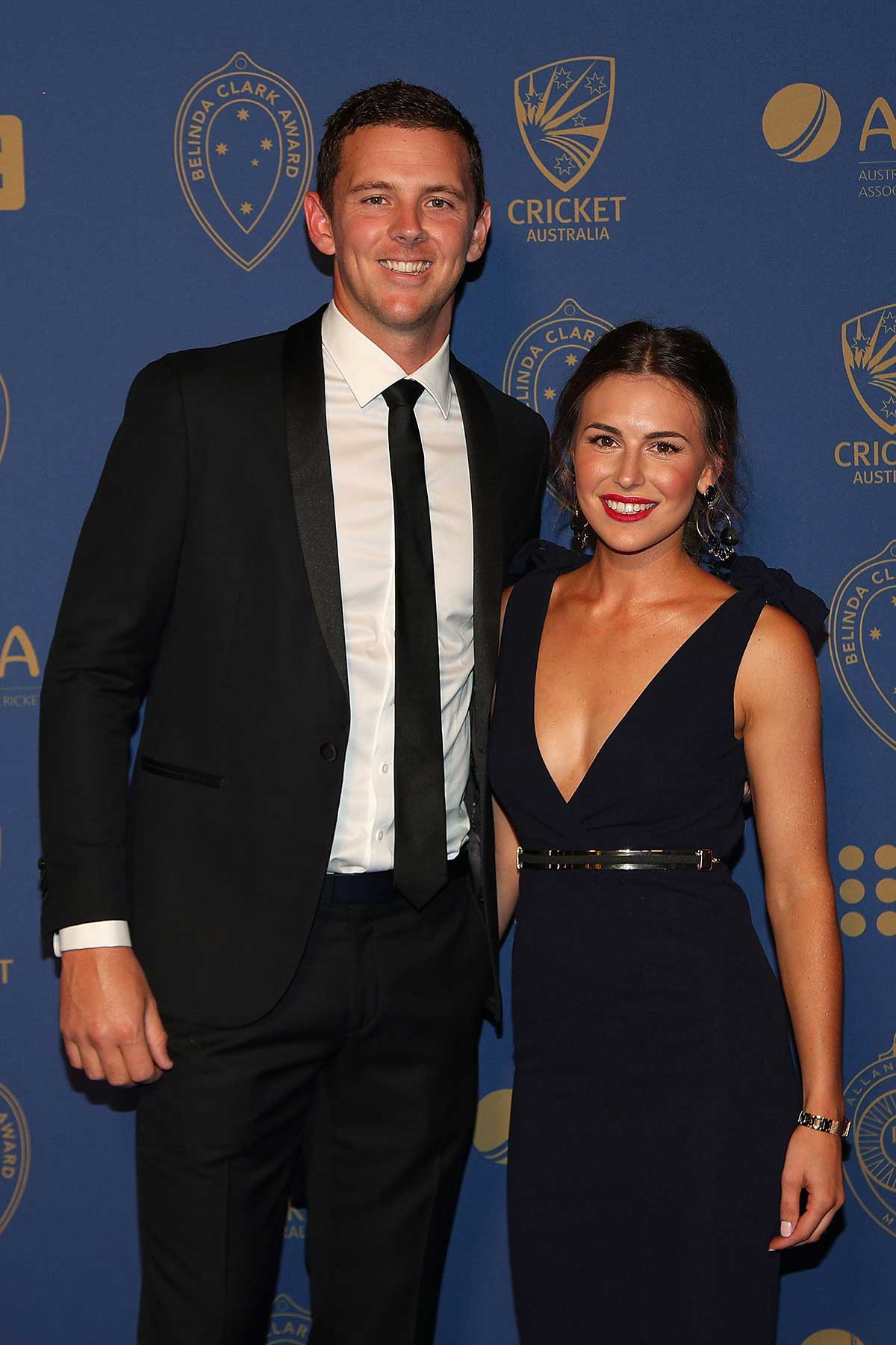 Aussie quick Josh Hazlewood and Cheri Christian // Getty
