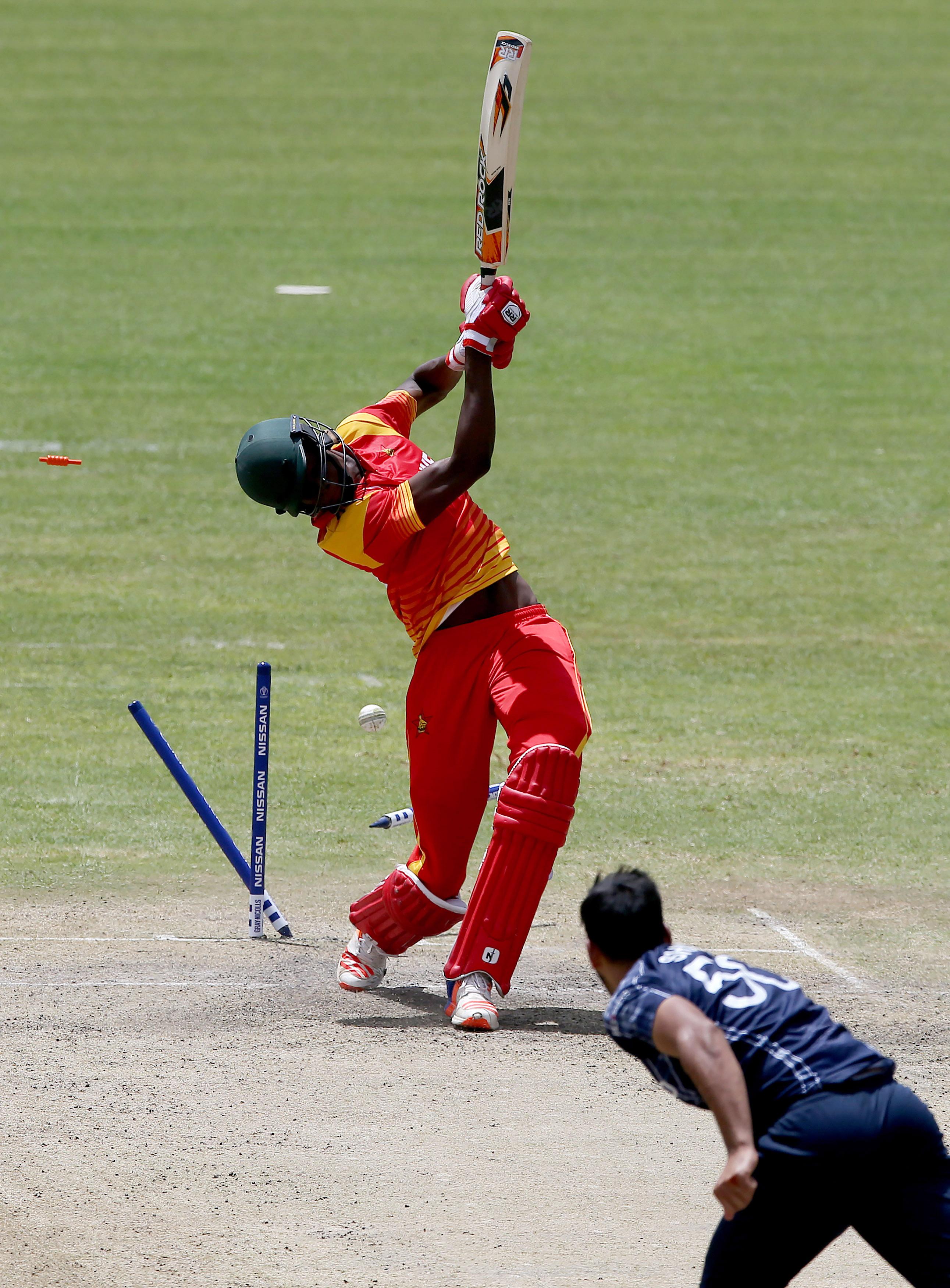 Zimbabwe's Blessing Muzarabani has his woodwork rearranged // ICC