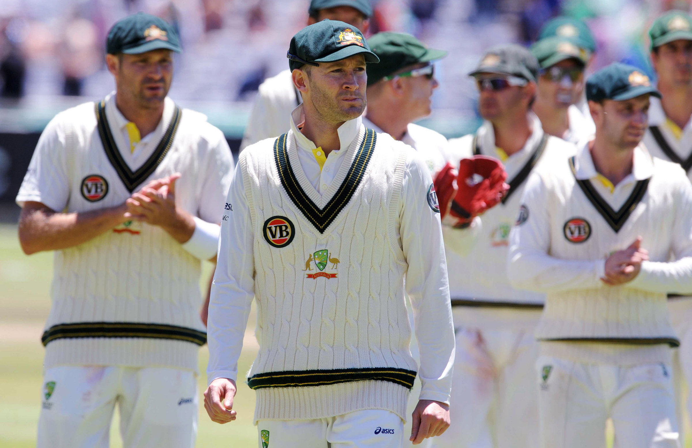 Clarke and Australia after being defeated by eight wickets // Getty