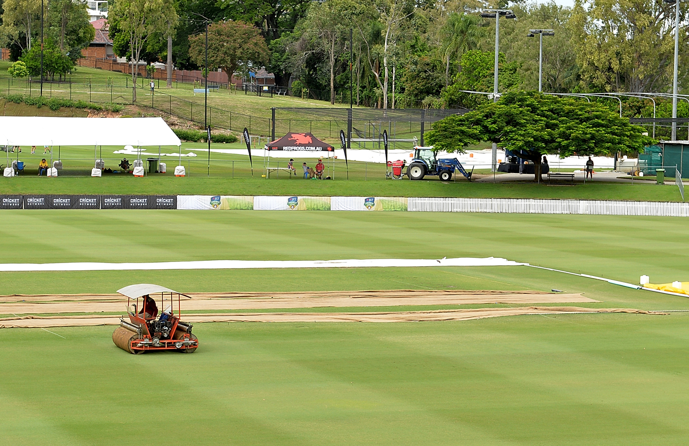 Groundstaff operate a super sopper on day one // Getty